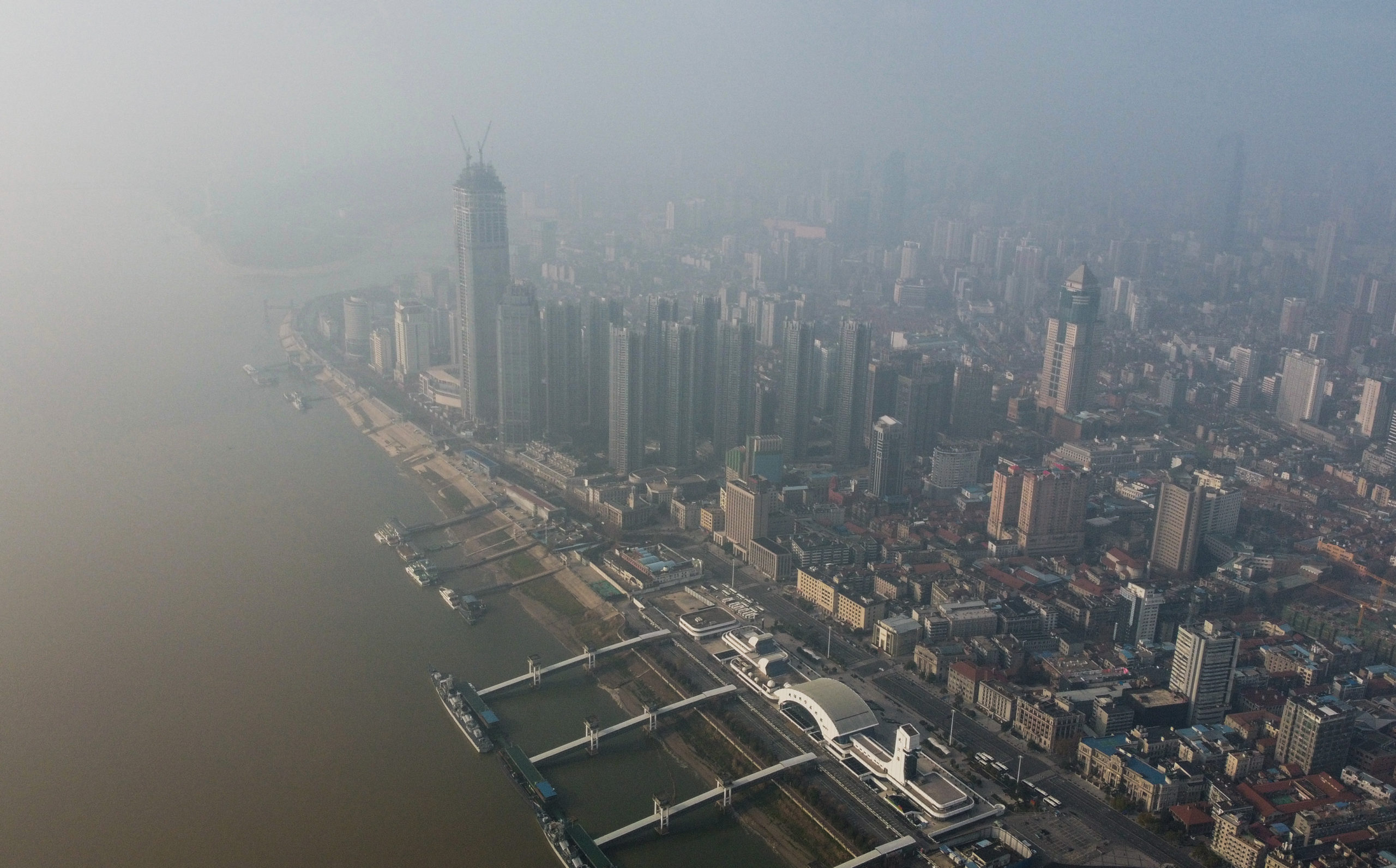 An aerial view shows residential and commercial buildings of Wuhan in China's central Hubei province on January 27, 2020, amid a deadly virus outbreak in the city. - The deadly new coronavirus that has broken out in China, 2019-nCoV, will afflict a minimum of tens of thousands of people and will last at least several months, researchers estimate based on the first available data. (Photo by Hector RETAMAL / AFP) (Photo by HECTOR RETAMAL/AFP via Getty Images)