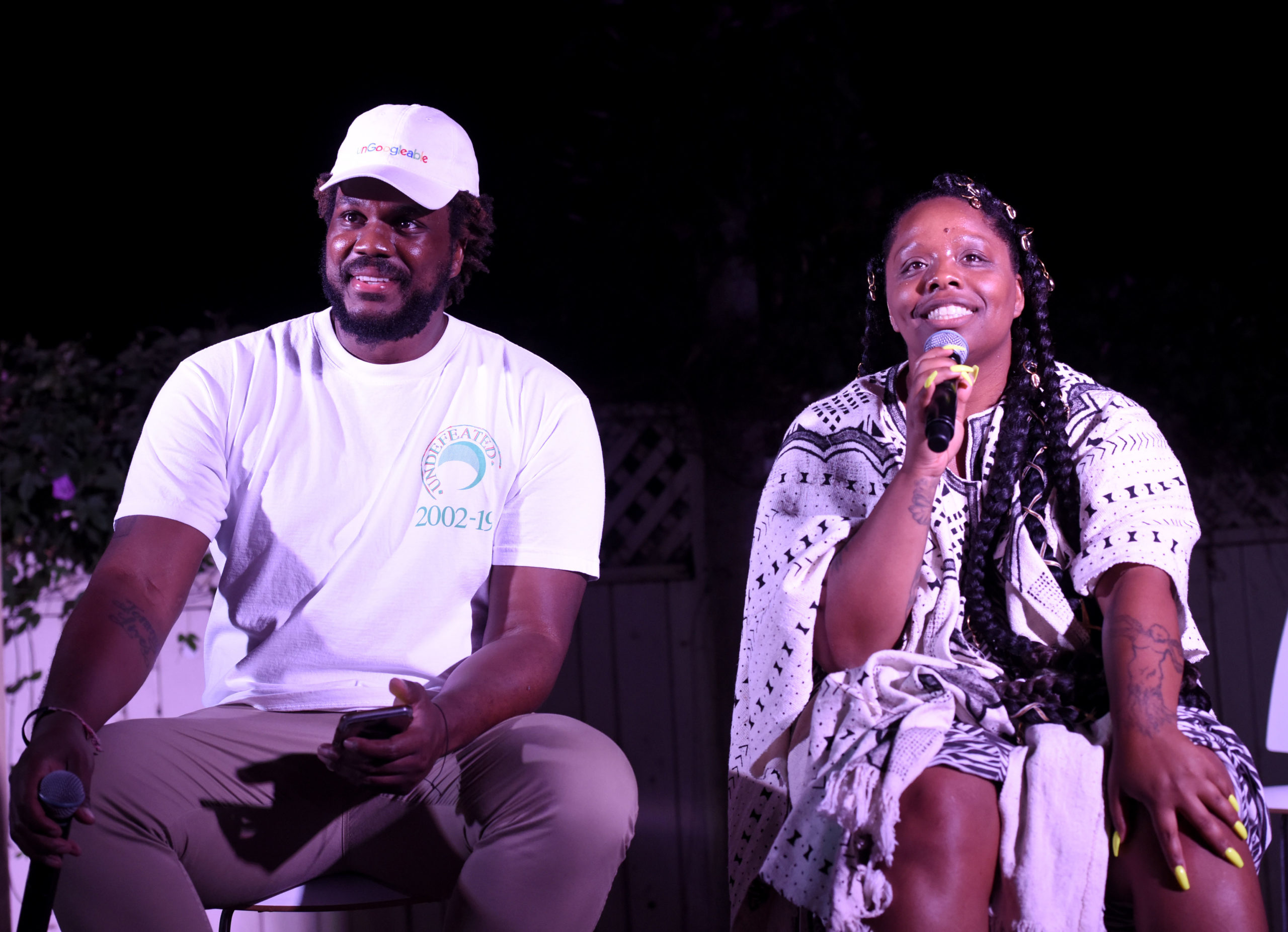 Damon Turner and Patrisse Cullors speak at Patrisse Cullors' Thesis Solo Show on April 18, 2019, in Los Angeles, California. (Vivien Killilea/Getty Images for Patrisse Cullors)