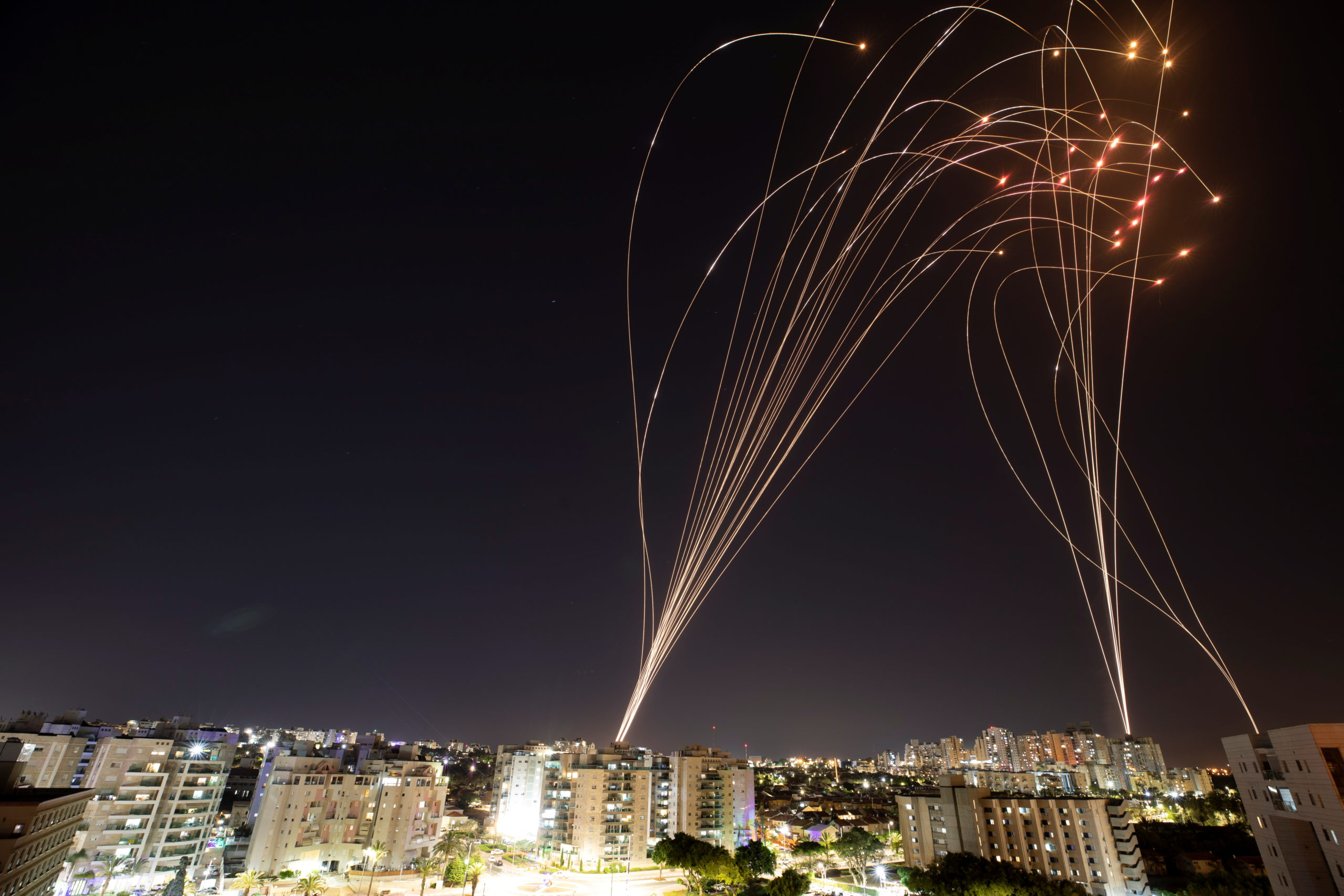 Streaks of light are seen as Israel's Iron Dome anti-missile system intercepts rockets launched from the Gaza Strip towards Israel, as seen from Ashkelon, Israel, May 11, 2021. (REUTERS/Nir Elias)