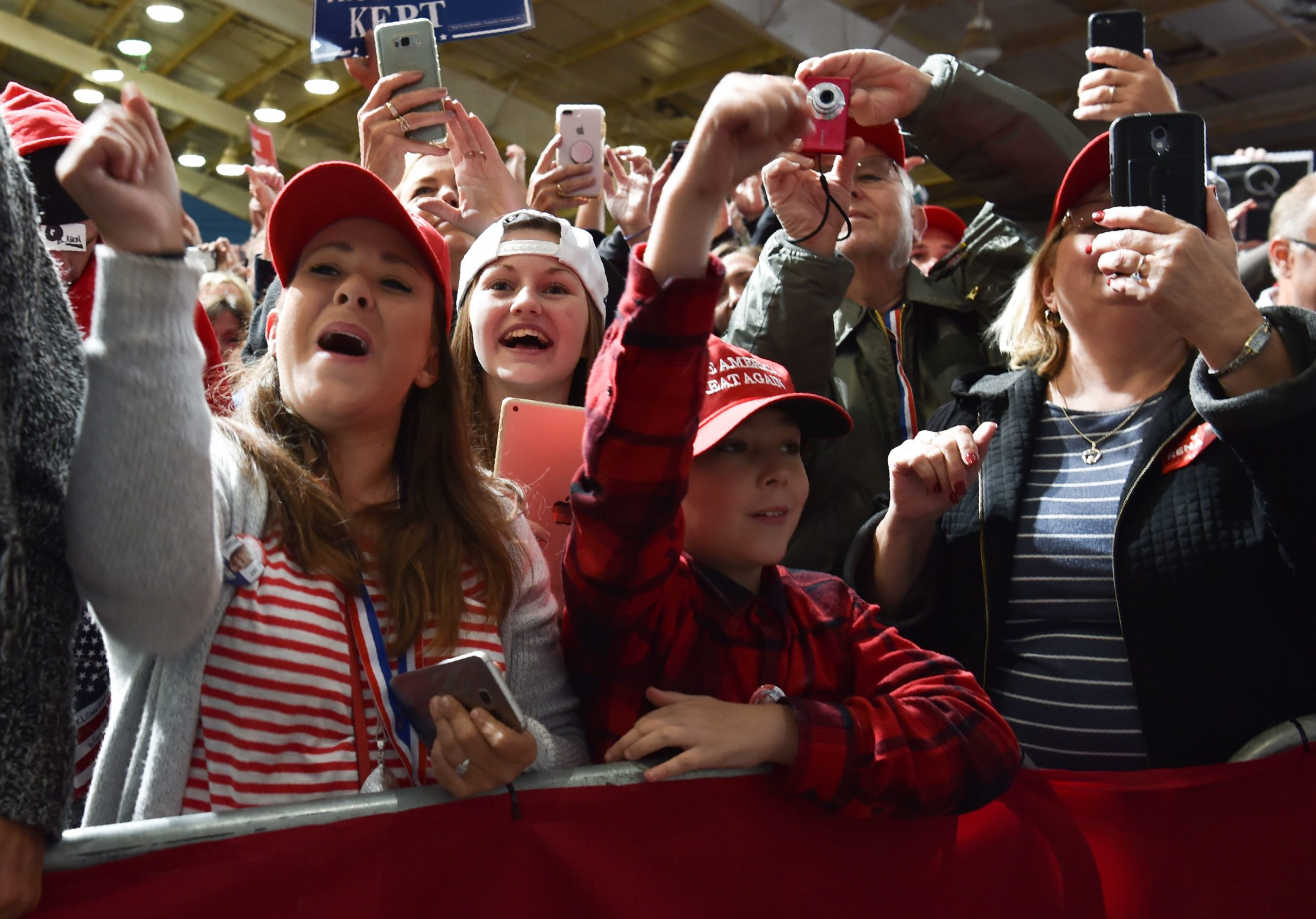 """Supporters of US President Donald Trump (off frame) cheer and clap during his speech at a """"Make America Great Again"""" rally in Lebanon, Ohio, on October 12, 2018. (Photo by Nicholas Kamm / AFP) (Photo credit NICHOLAS KAMM/AFP via Getty Images)"""