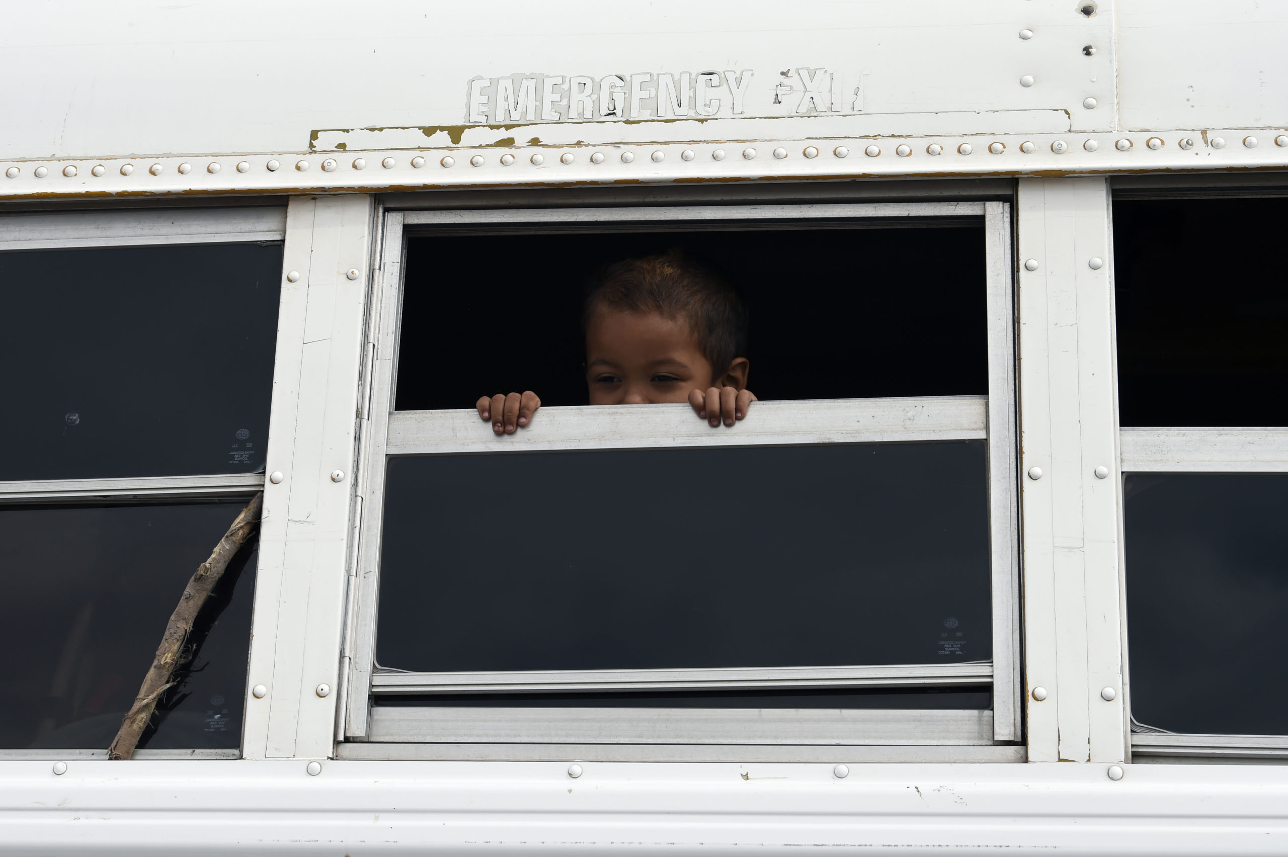 A Central American migrant child moving in a caravan towards the United States, is seen onboard a bus on the road linking Guaymas and Hermosillo, Sonora state, Mexico, on November 14, 2018. (Photo credit should read ALFREDO ESTRELLA/AFP via Getty Images)