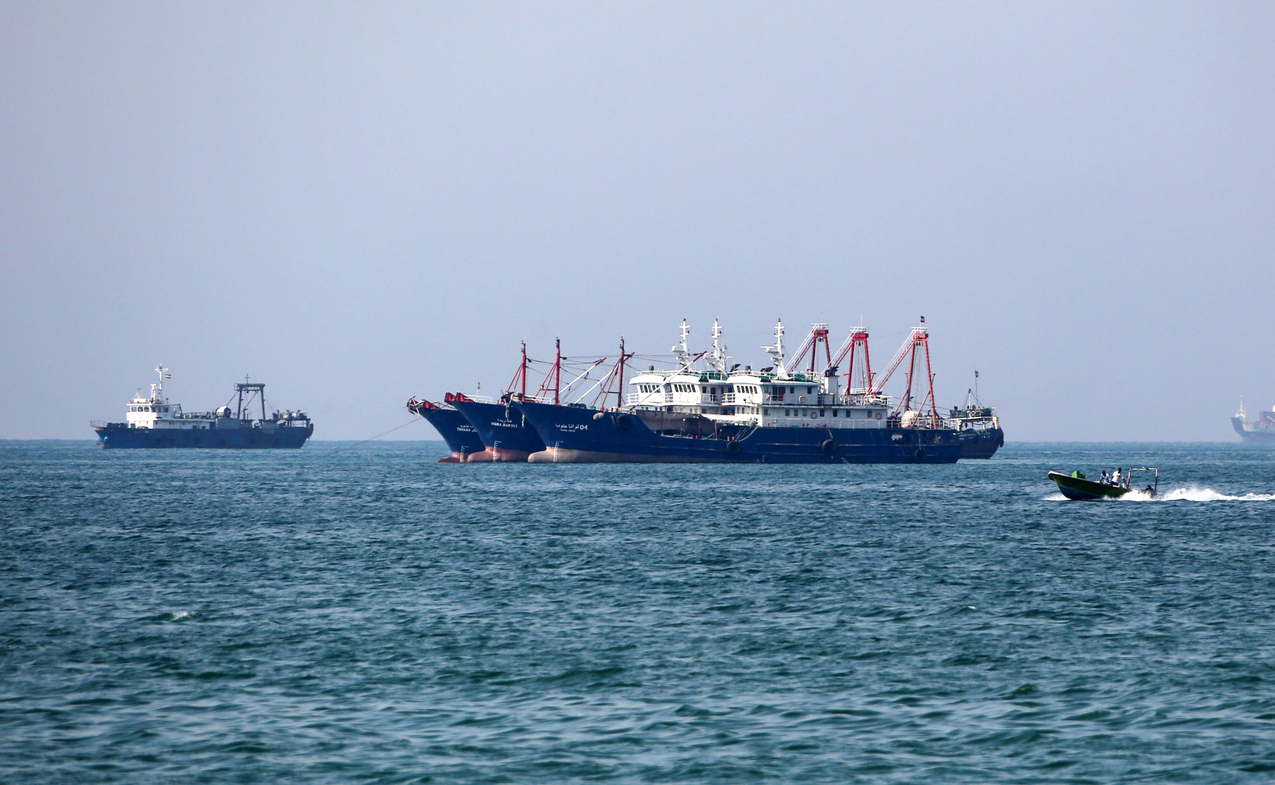 Fishing ships are pictured in the Gulf off the Iranian port city of Bandar Abbas, which is the main base of the Islamic republic's navy and has a strategic position on the Strait of Hormuz, on April 29, 2019. (Photo by ATTA KENARE/AFP via Getty Images)