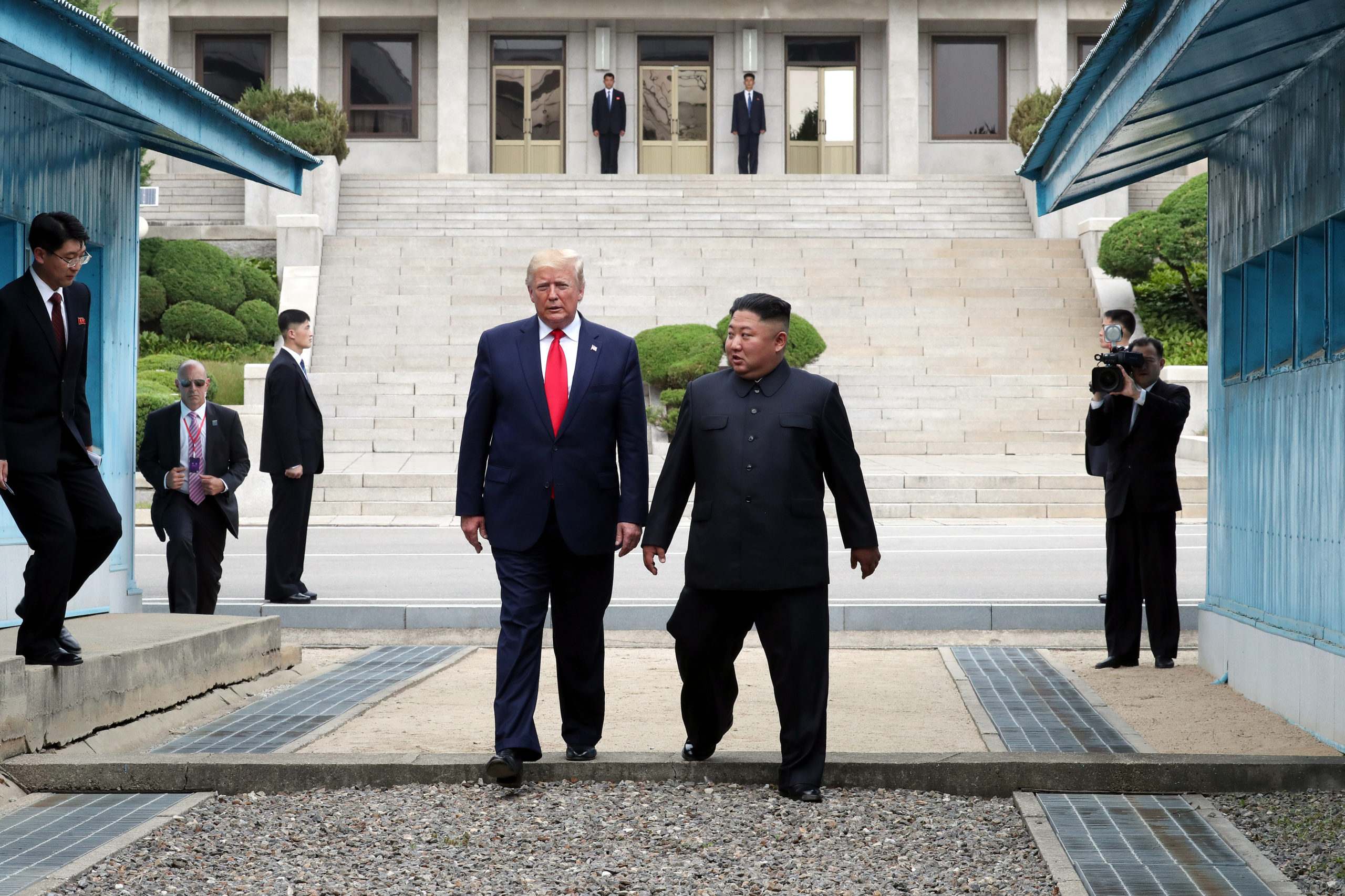 North Korean leader Kim Jong Un and U.S. President Donald Trump inside the demilitarized zone separating the South and North Korea on June 30, 2019 in Panmunjom, South Korea. (Dong-A Ilbo/Handout/Getty Images)
