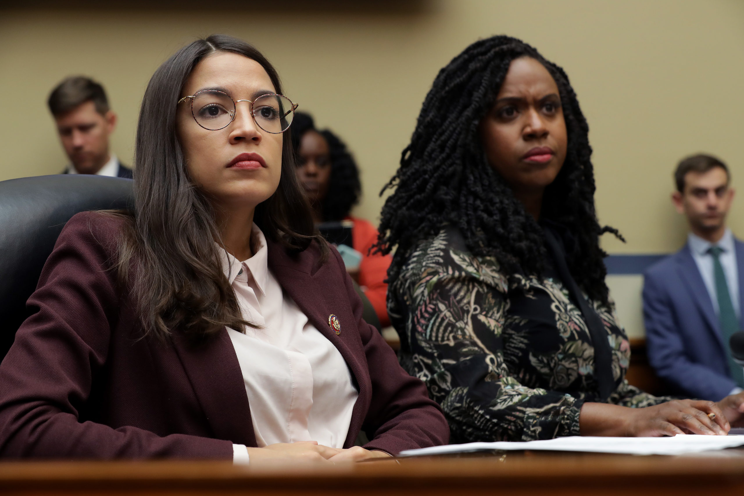House Oversight and Government Reform Committee members Rep. Alexandria Ocasio-Cortez (D-NY) (L) and Rep. Ayanna Pressley (D-MA) attend a hearing on drug pricing in the Rayburn House Office building on Capitol Hill July 26, 2019 in Washington, DC. As members of a group of four freshman Democratic women of color, known informally as 'The Squad,' the congresswomen heard testimony from patients and their family members about the negative impacts of rising drug prices in the United States. (Photo by Chip Somodevilla/Getty Images)
