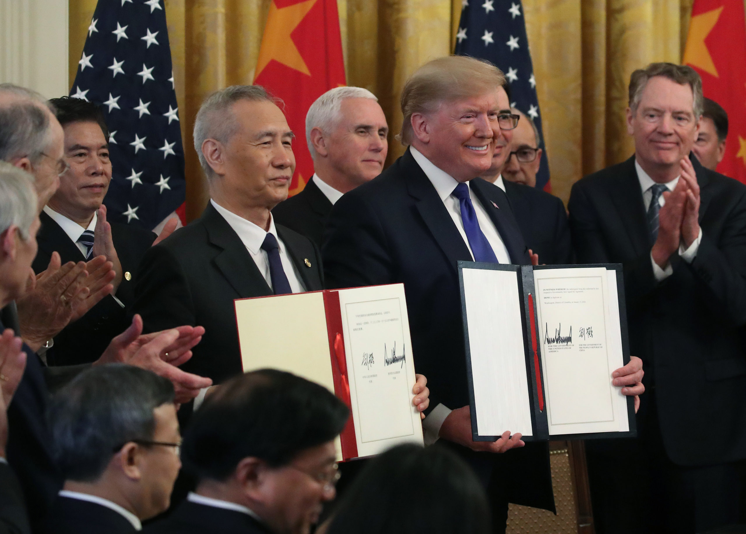 President Donald Trump and Chinese Vice PremierLiuHe hold up signed agreements of a trade deal between the U.S. and China on Jan. 15, 2020. (Mark Wilson/Getty Images)