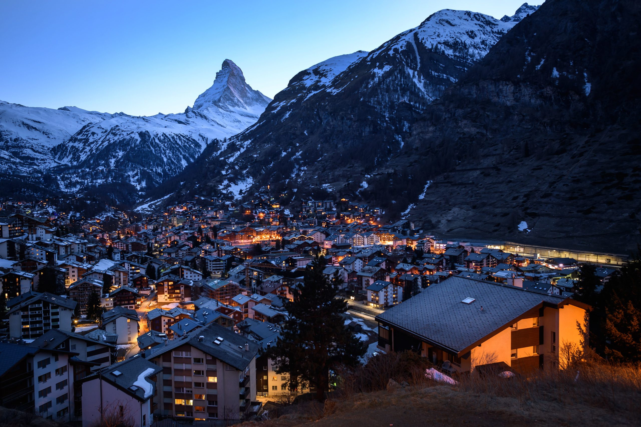 A picture taken on April 1, 2020 from the Swiss alpine resort of Zermatt shows in silhouette the iconic Matterhorn mountain located on the Italian-Swiss border that peaks at 4478 meters amid the spread of coronavirus disease (COVID-19). - The Matterhorn overlooks the ski resort of Zermatt deep down in the valley below. The normally-bustling town is devoid of tourists, hotels and holiday homes largely empty. Switzerland has shut schools, bars, restaurants and non-food shops in a bid to halt the spread of the virus. (Photo by Fabrice COFFRINI / AFP) (Photo by FABRICE COFFRINI/AFP via Getty Images)