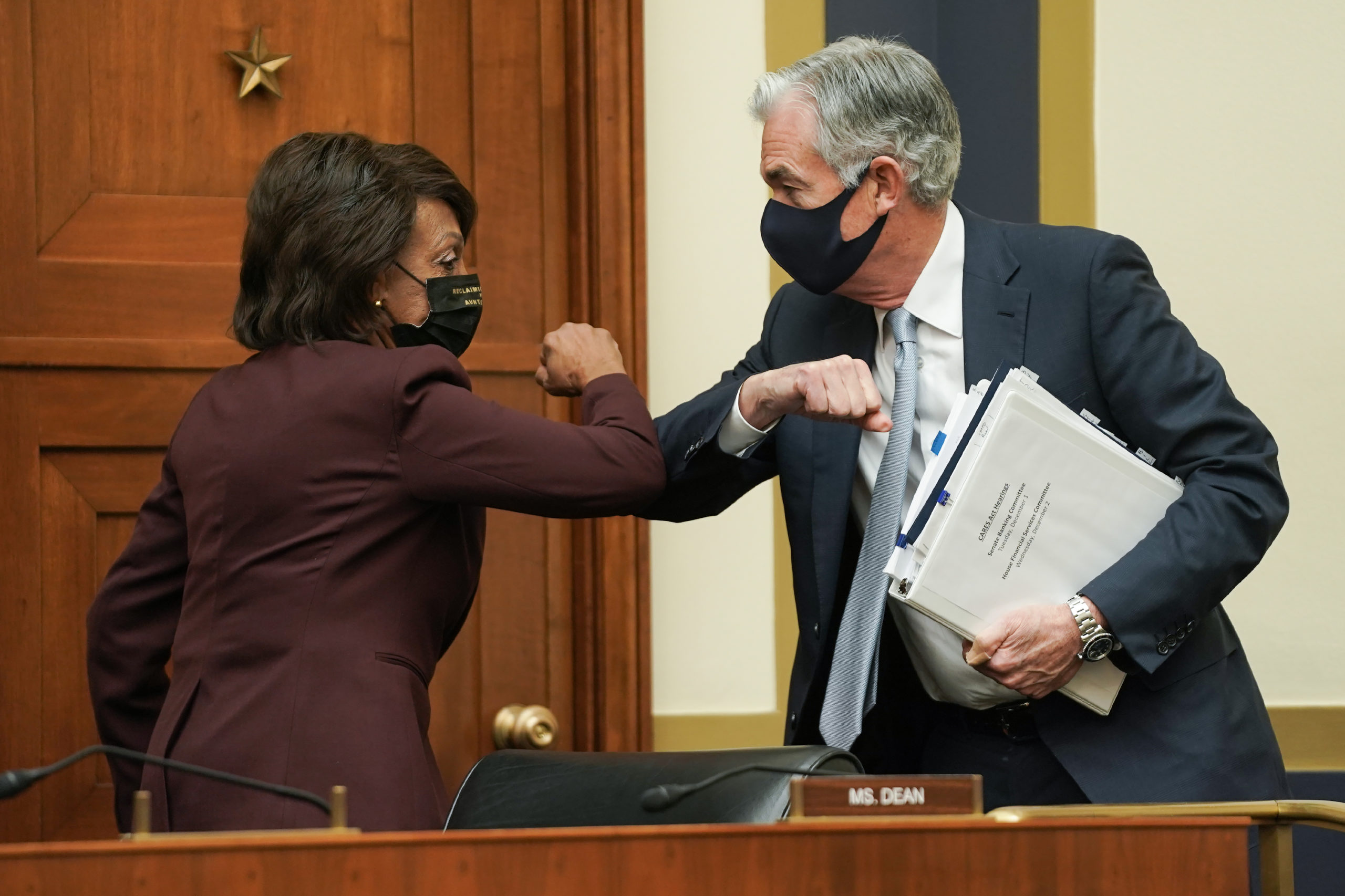 House Financial Services Committee Chairwoman Maxine Waters elbow bumps Federal Reserve Chair Jerome Powell in December. (Getty Images)
