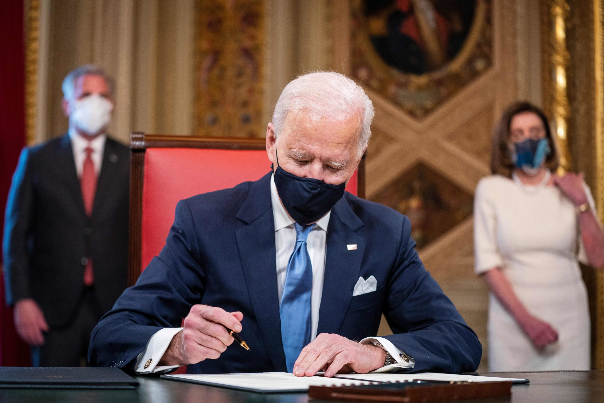 US President Joe Biden signs three documents including an Inauguration declaration, cabinet nominations and sub-cabinet noinations in the Presidents Room at the US Capitol after being sworn-in as the 46th president of the United States on January 20, 2021. (Photo by JIM LO SCALZO / POOL / AFP) (Photo by JIM LO SCALZO/POOL/AFP via Getty Images)