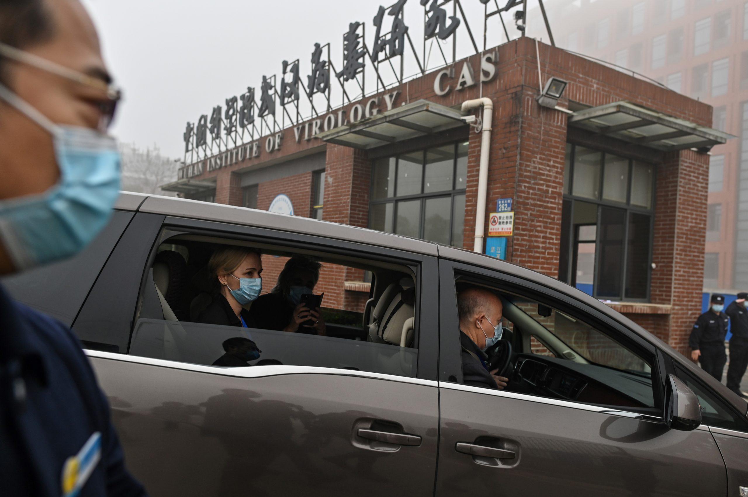 Members of the World Health Organization arrive at the Wuhan Institute of Virology in on Feb. 3. (Hector Retamal/AFP via Getty Images)
