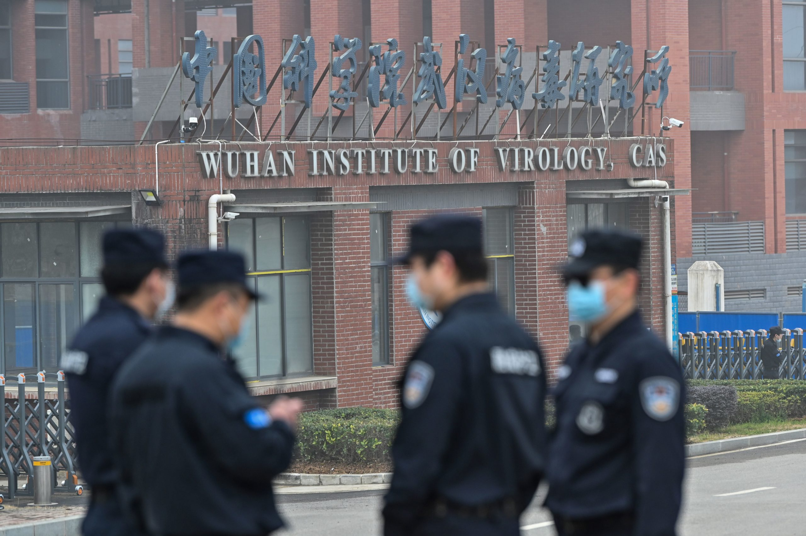 Security personnel stand guard outside the Wuhan Institute of Virology in February. (Hector Retamal/AFP via Getty Images)