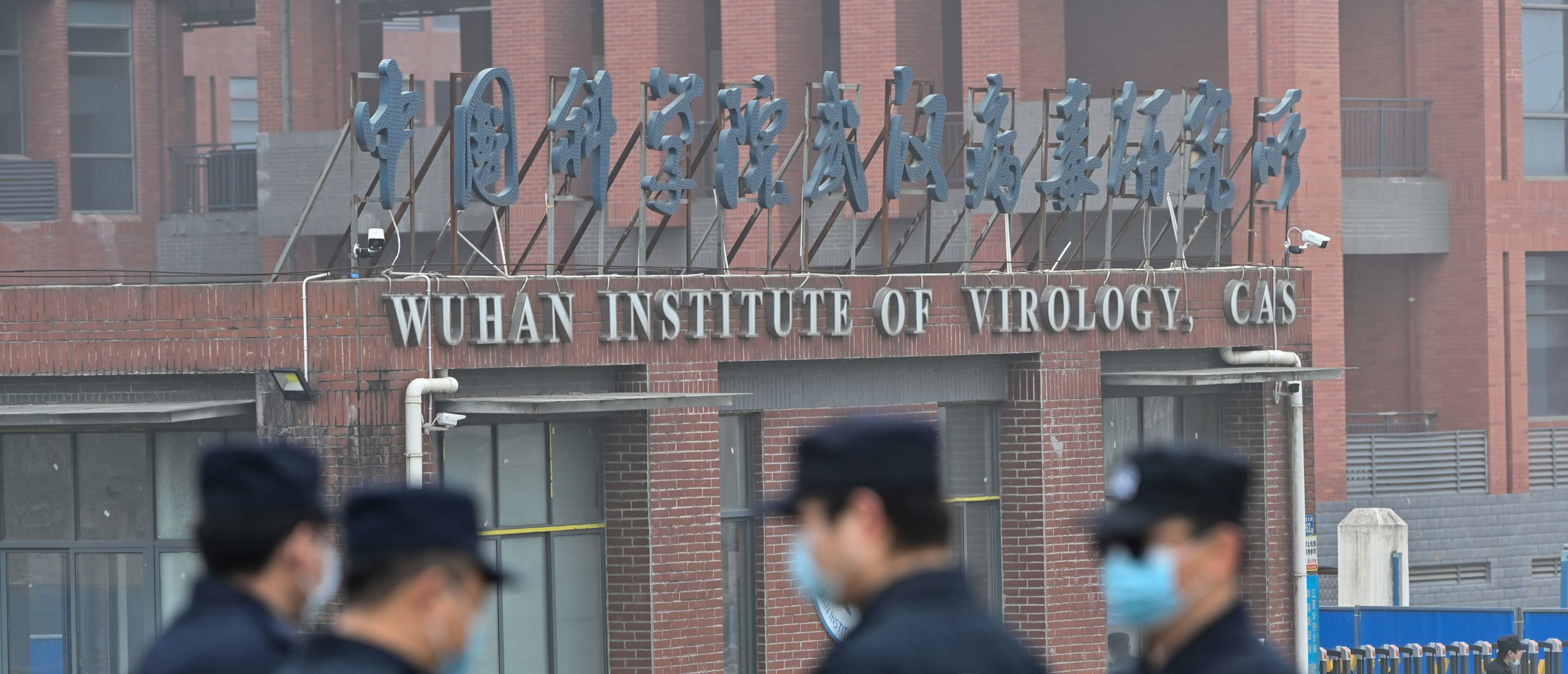 Security personnel stand guard outside the Wuhan Institute of Virology in Wuhan as members of the World Health Organization (WHO) team investigating the origins of the COVID-19 coronavirus make a visit to the institute in Wuhan in China's central Hubei province on February 3, 2021. (Photo by HECTOR RETAMAL/AFP via Getty Images)