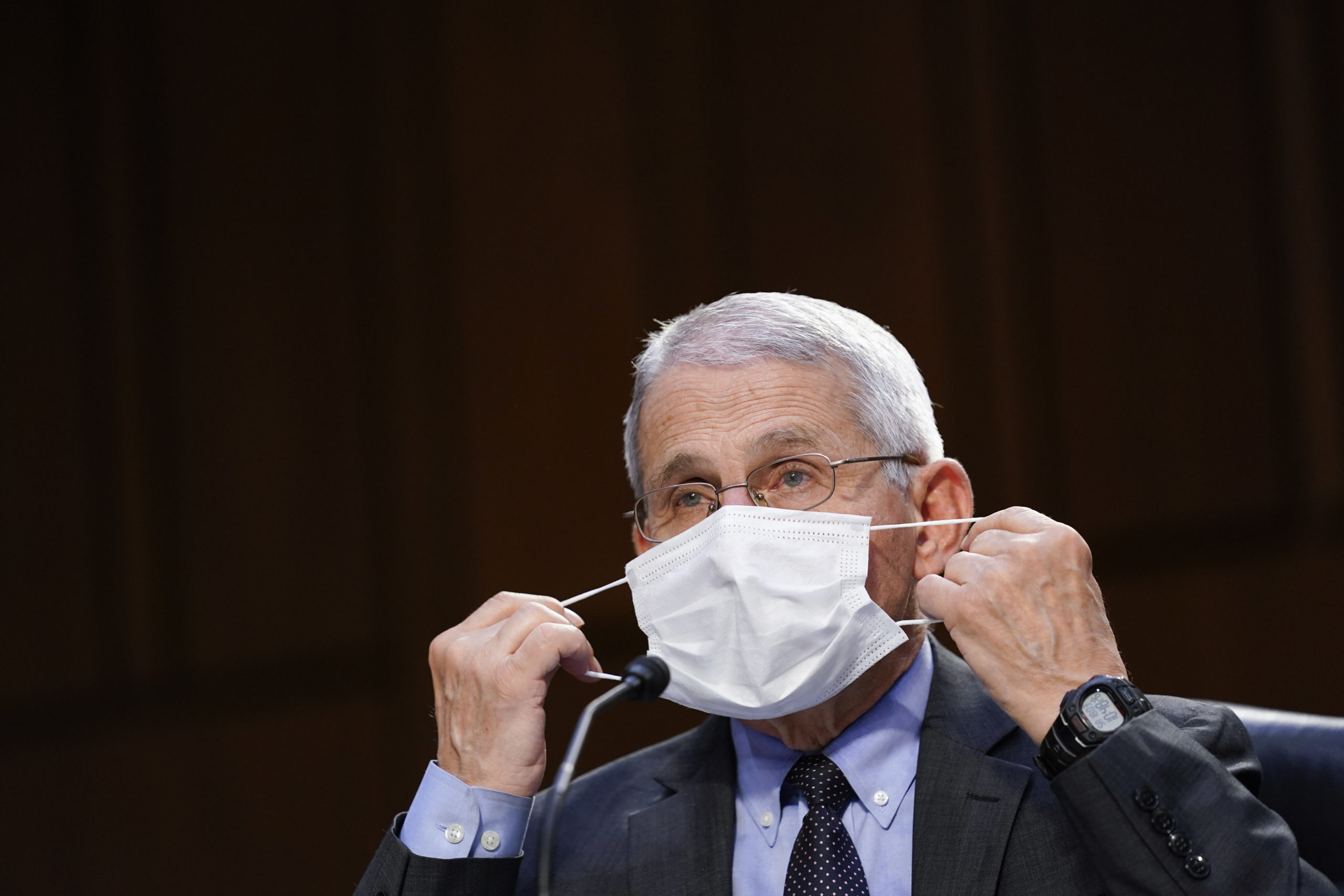 WASHINGTON, DC - MARCH 18: Dr. Anthony Fauci, director of the National Institute of Allergy and Infectious Diseases, adjusts a face mask during a Senate Health, Education, Labor and Pensions Committee hearing on the federal coronavirus response on Capitol Hill on March 18, 2021 in Washington, DC. (Photo by Susan Walsh-Pool/Getty Images)