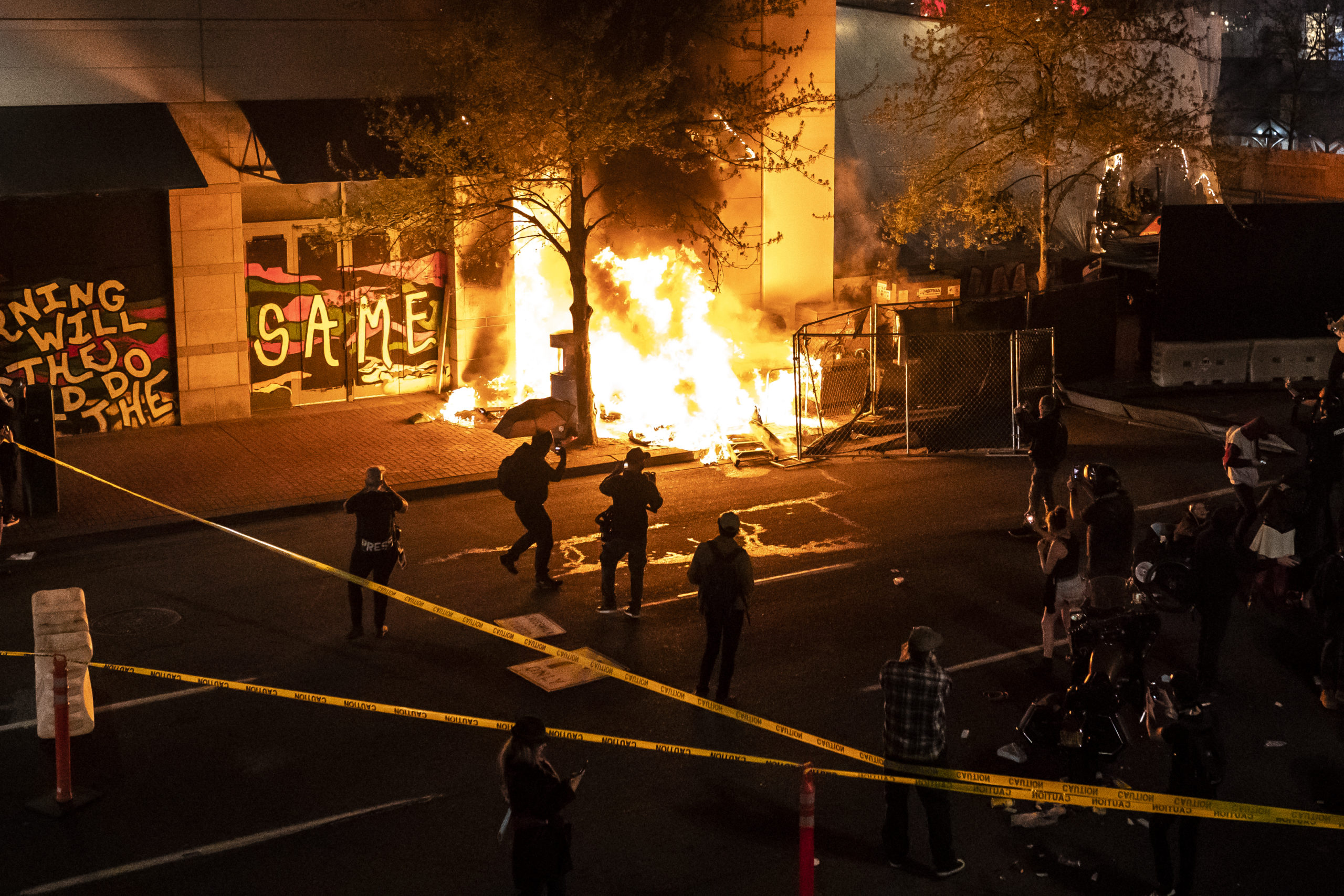 PORTLAND, OR - APRIL 17: Protesters watch a structure fire, set following the police shooting of a homeless man on April 17, 2021 in Portland, Oregon. The shooting comes amid heightened tensions between police and activists as the country awaits a verdict in the trial of Derek Chauvin. (Photo by Nathan Howard/Getty Images)