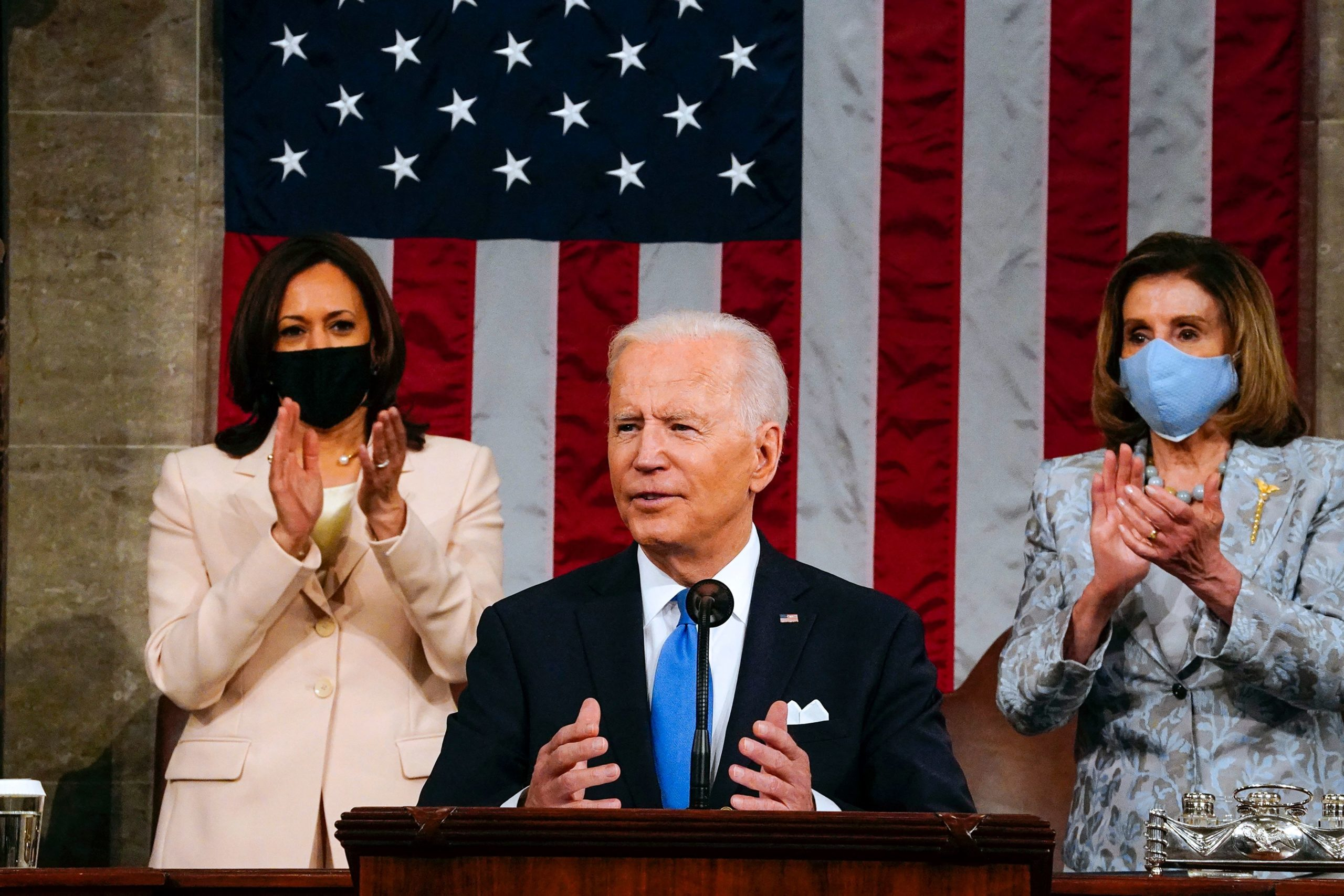 US Vice President Kamala Harris (L) and Speaker of the House of Representatives Nancy Pelos (R) applaud as US President Joe Biden addresses a joint session of Congress at the US Capitol in Washington, DC, on April 28, 2021. (Photo by Melina Mara / POOL / AFP) (Photo by MELINA MARA/POOL/AFP via Getty Images)