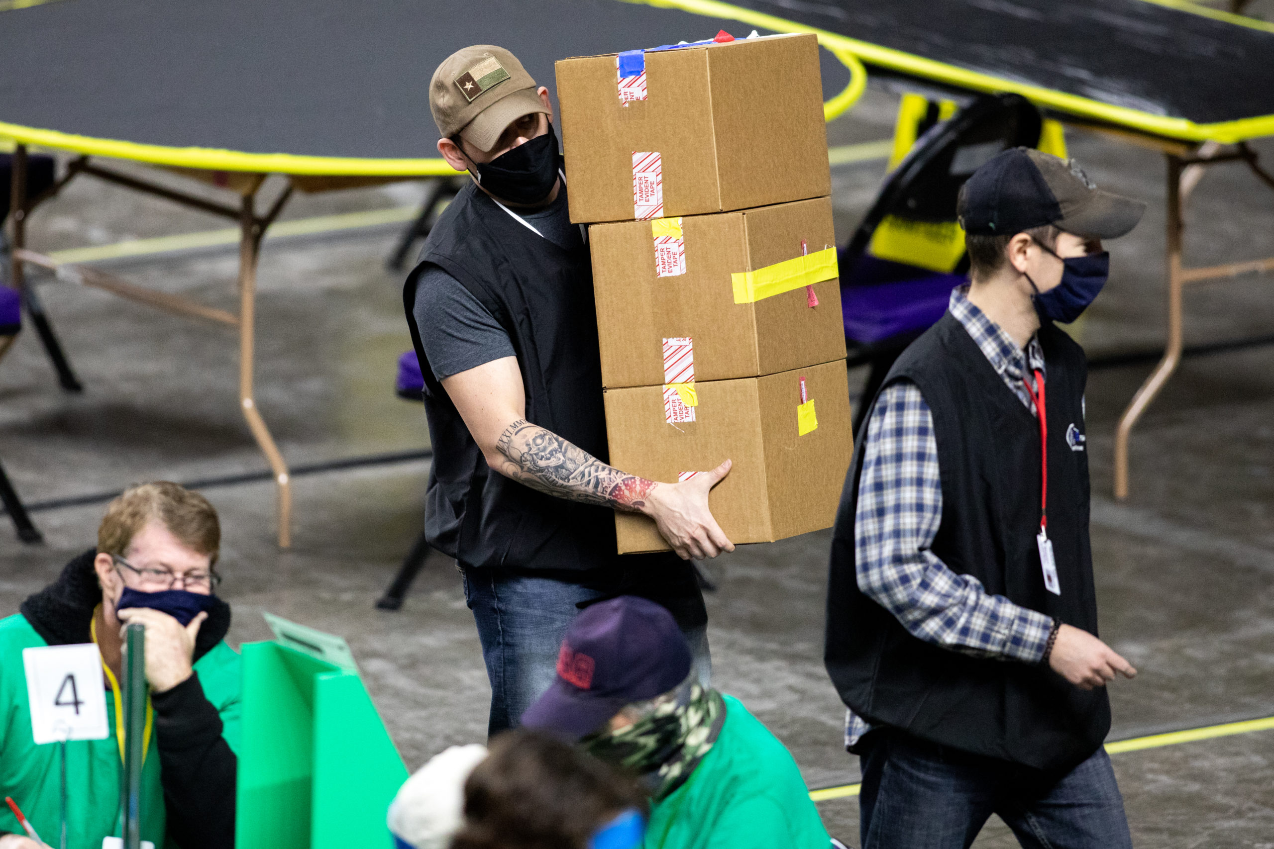 Workers hired by the Arizona State Senate examine and recount ballots from the 2020 general election at Veterans Memorial Coliseum on May 1 in Phoenix, Arizona. (Courtney Pedroza/Getty Images)