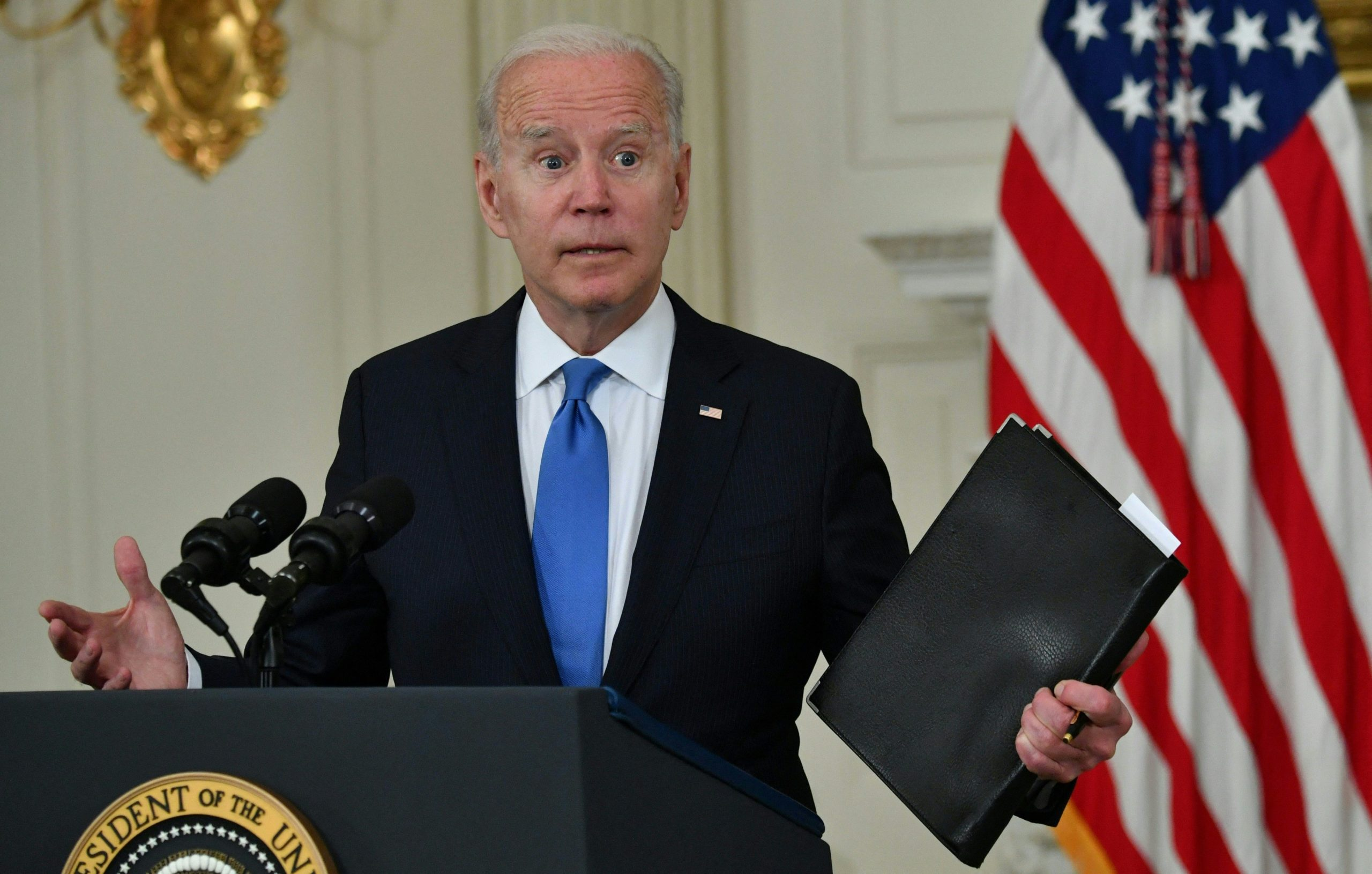 US President Joe Biden delivers remarks on the American Rescue Plan in the State Dining Room of the White House on May 5, 2021. (NICHOLAS KAMM/AFP via Getty Images)