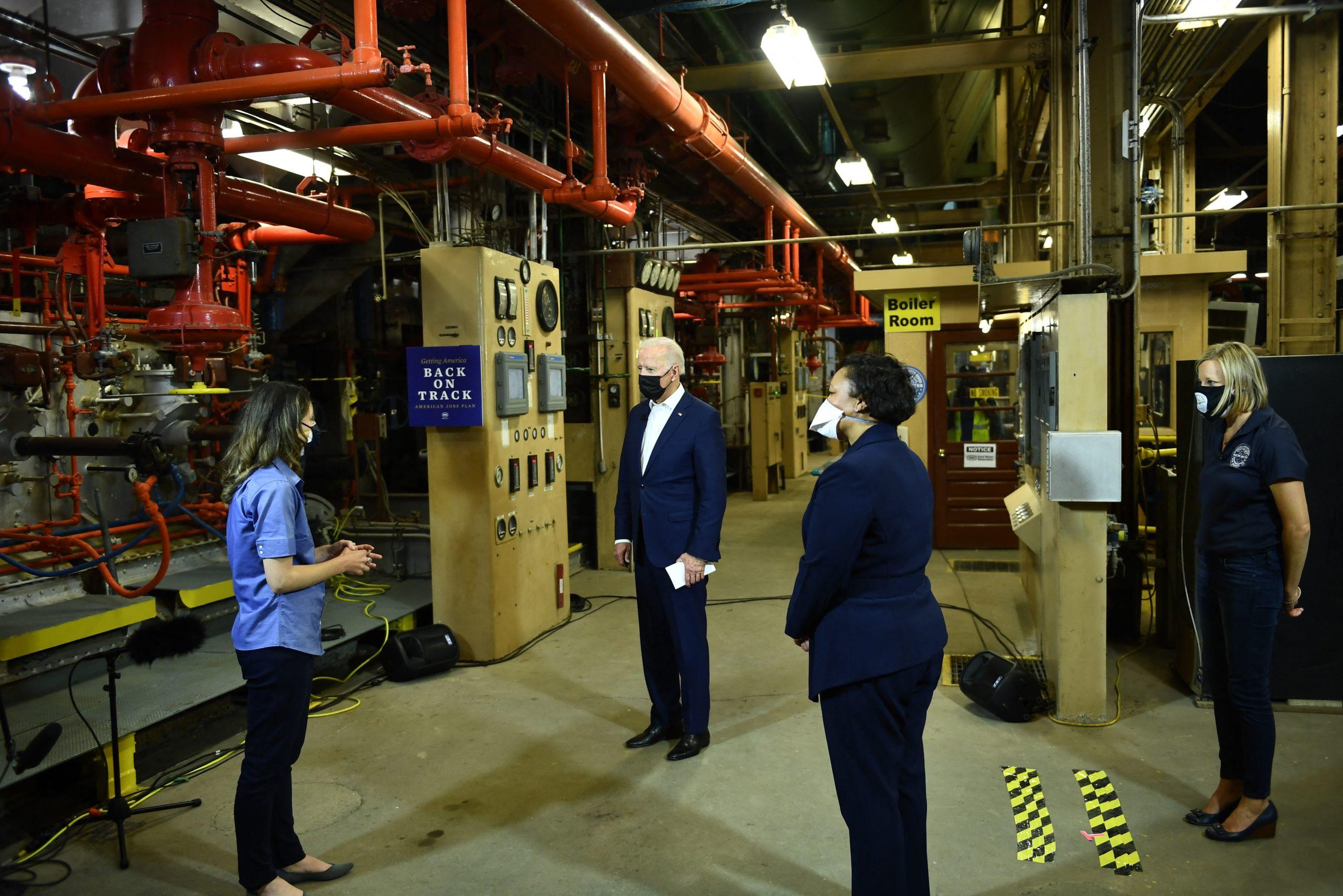 President Joe Biden and New Orleans Mayor LaToya Cantrell listen as they tour the Carrollton water treatment plant in New Orleans, Louisiana on Thursday. (Brendan Smialowski/AFP via Getty Images)