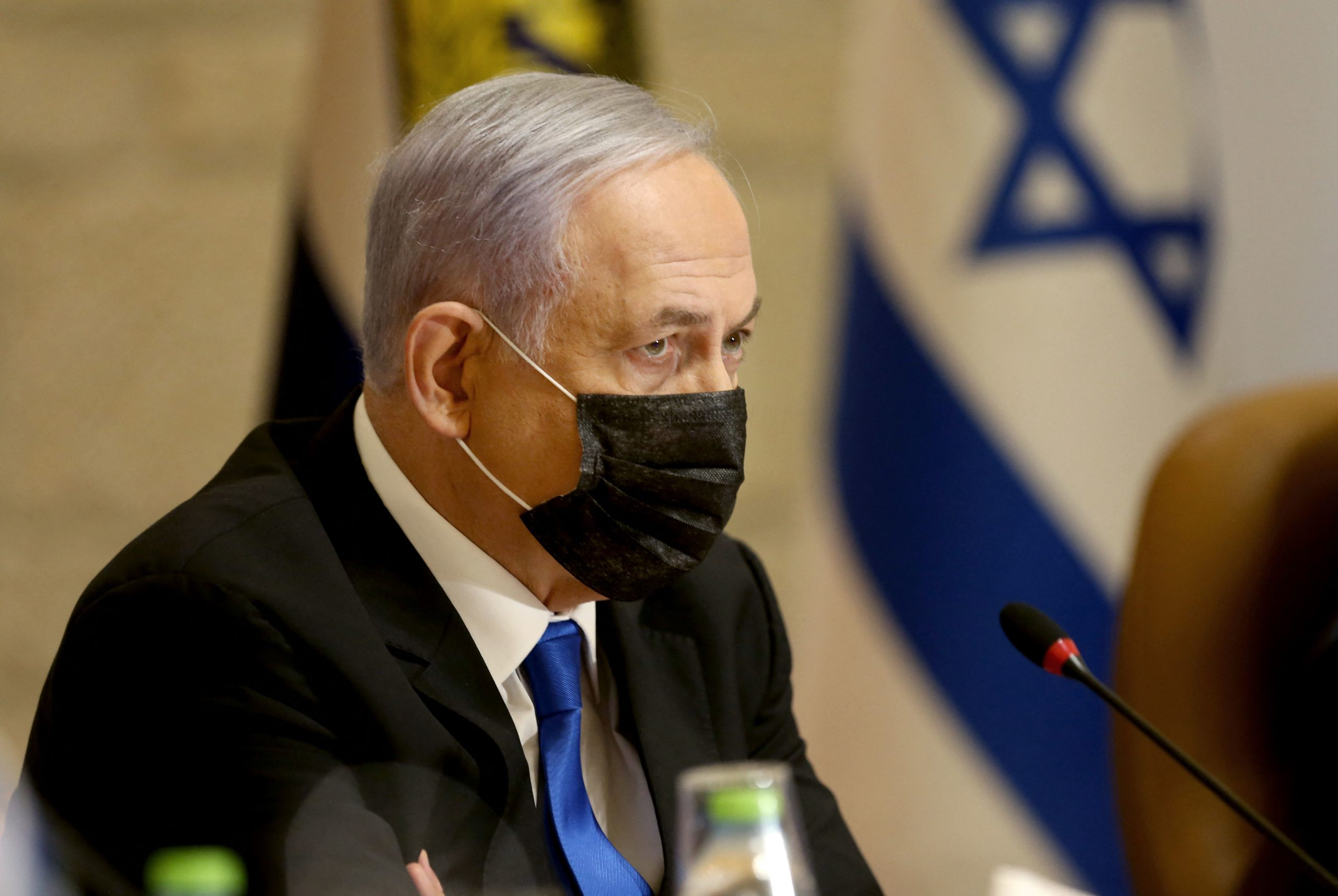 """Israeli Prime Minister Benjamin Netanyahu, wearing a mask for protection against the COVID-19 pandemic, attends a special cabinet meeting on the occasion of """"Jerusalem Day"""" at the city's municipality building on May 9, 2021. (AMIT SHABI/POOL/AFP via Getty Images)"""
