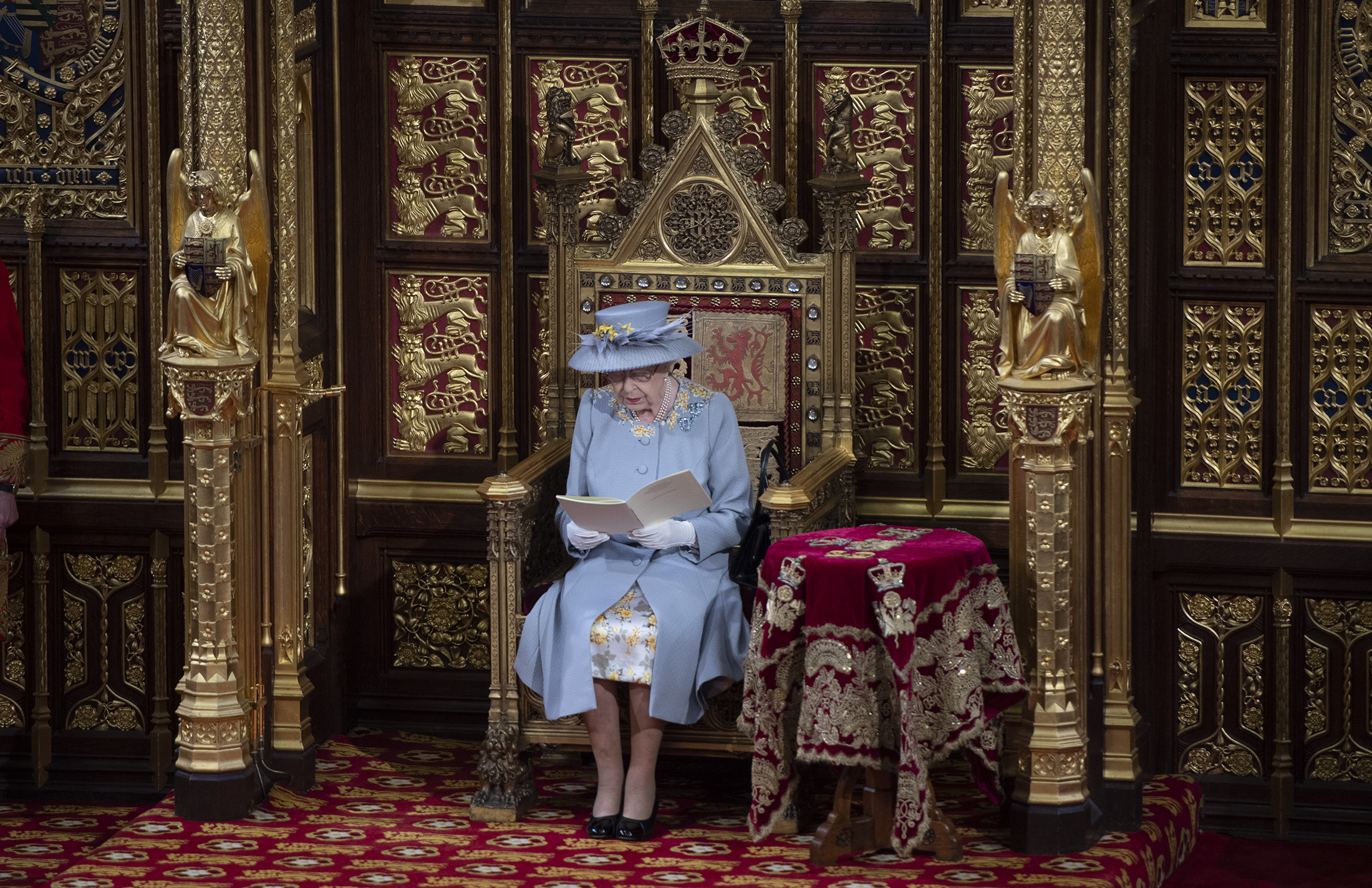 LONDON, ENGLAND - MAY 11: Queen Elizabeth II delivers the Queen's Speech in the House of Lord's Chamber with Prince Charles, Prince of Wales and Camilla, Duchess of Cornwall seated (R) during the State Opening of Parliament at the House of Lords on May 11, 2021 in London, England. (Photo by Eddie Mulholland - WPA Pool/Getty Images)