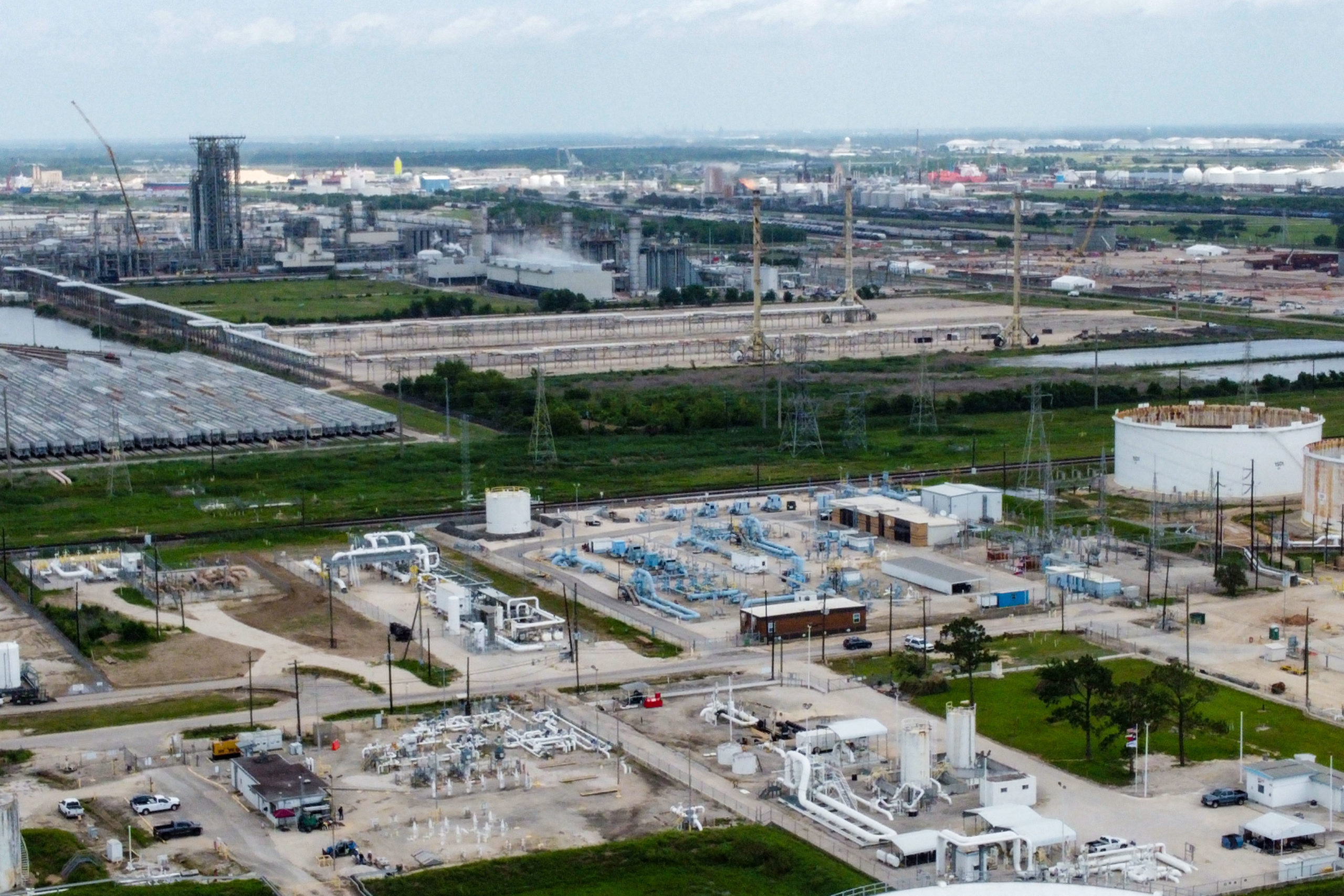 Image showing the Colonial Pipeline Houston Station facility in Pasadena, Texas (East of Houston) taken on May 10, 2021. (eds note : Colonial pipeline facilities are the pale blue pipes in the center of the image, other installations belong to different companies.) - US President Joe Biden said that a Russia-based group was behind the ransomware attack that forced the shutdown of the largest oil pipeline in the eastern United States. The FBI identified the group behind the hack of Colonial Pipeline as DarkSide, a shadowy operation that surfaced last year and attempts to lock up corporate computer systems and force companies to pay to unfreeze them. (Photo by Francois PICARD / AFP) (Photo by FRANCOIS PICARD/AFP via Getty Images)