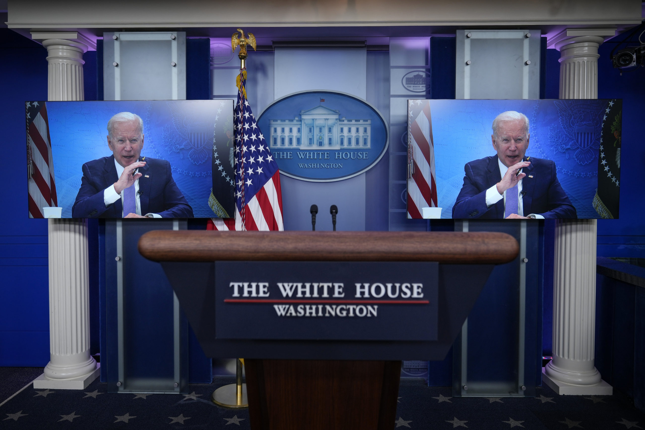 President Joe Biden is displayed on a monitor at the White House on Tuesday. (Drew Angerer/Getty Images)