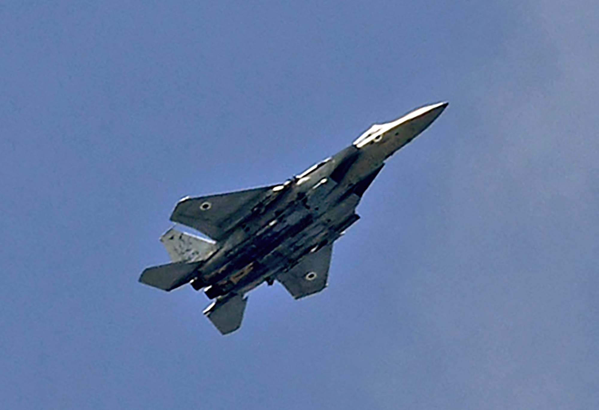 An Israeli army F-15 figher jet flies above the southern city of Ashkelon, Israel after conducting an air strike on the Gaza Strip on Wednesday. (Jack Guez/AFP via Getty Images)