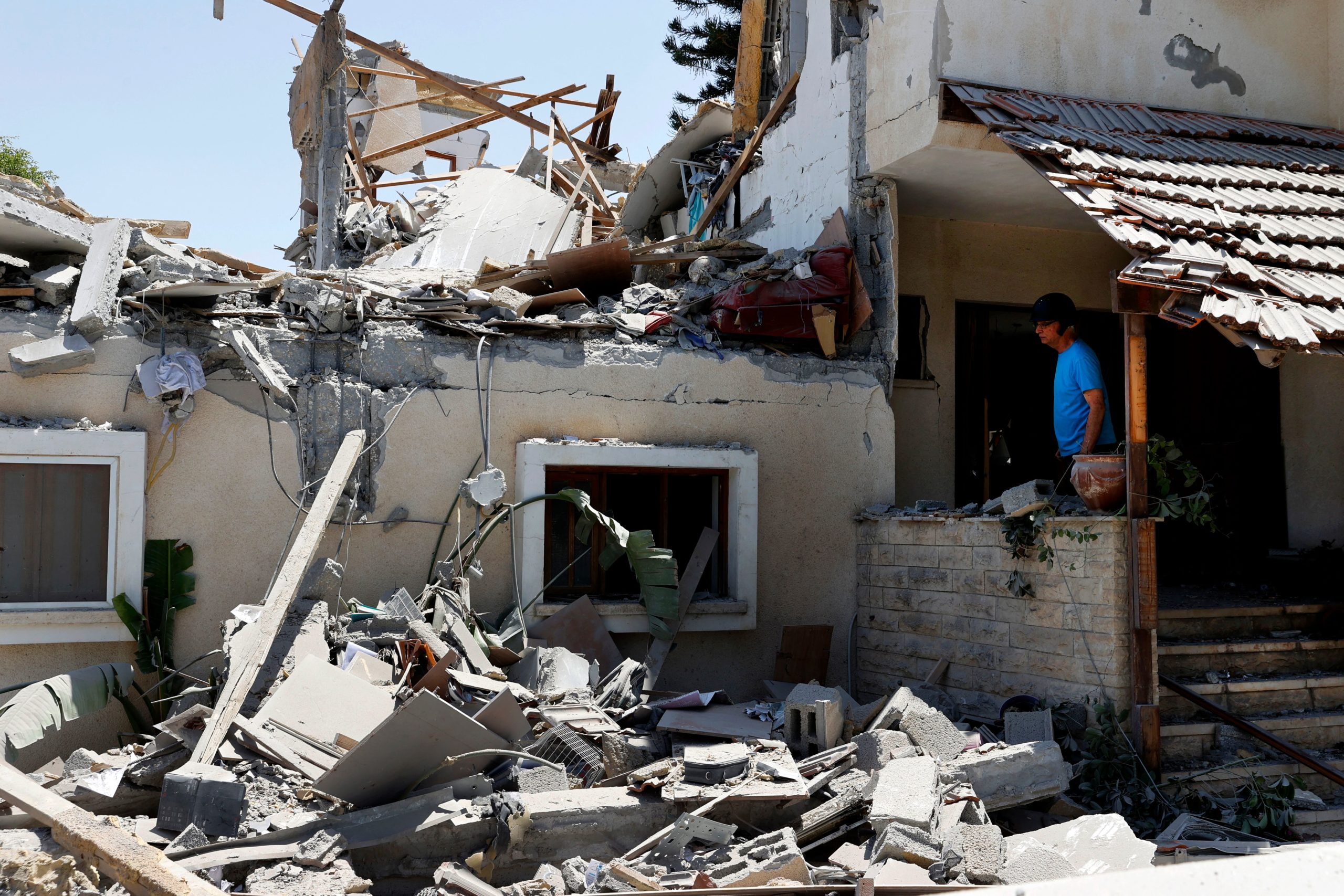 An Israeli citizen looks at the rubble caused by a rocket shot from Palestine by Hamas militants on Wednesday. (Jack Guez/AFP via Getty Images)