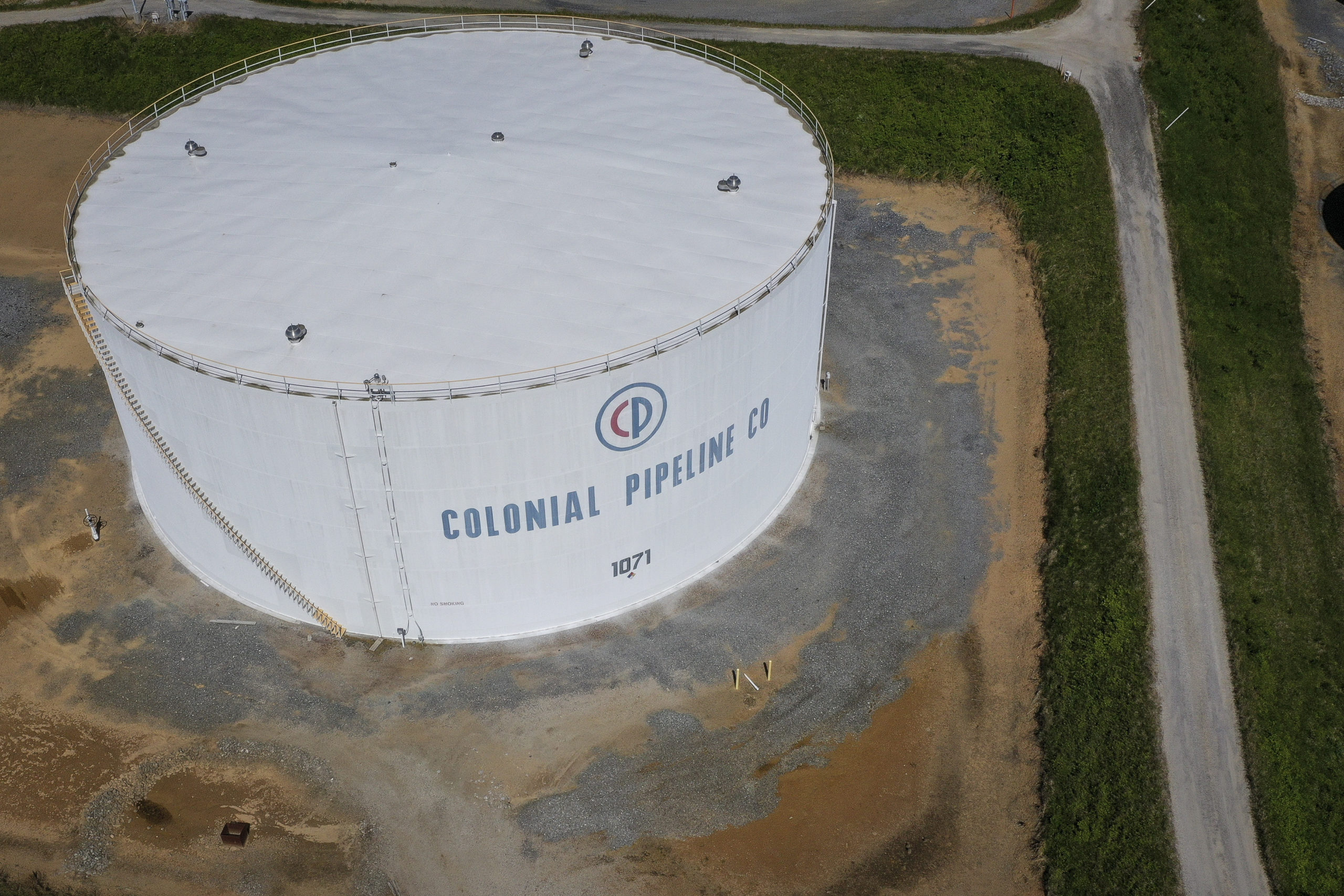 WOODBINE, MD - MAY 13: In an aerial view, fuel holding tanks are seen at Colonial Pipeline's Dorsey Junction Station on May 13, 2021 in Woodbine, Maryland. The Colonial Pipeline has returned to operations following a cyberattack that disrupted gas supply for the eastern U.S. for days. (Photo by Drew Angerer/Getty Images)