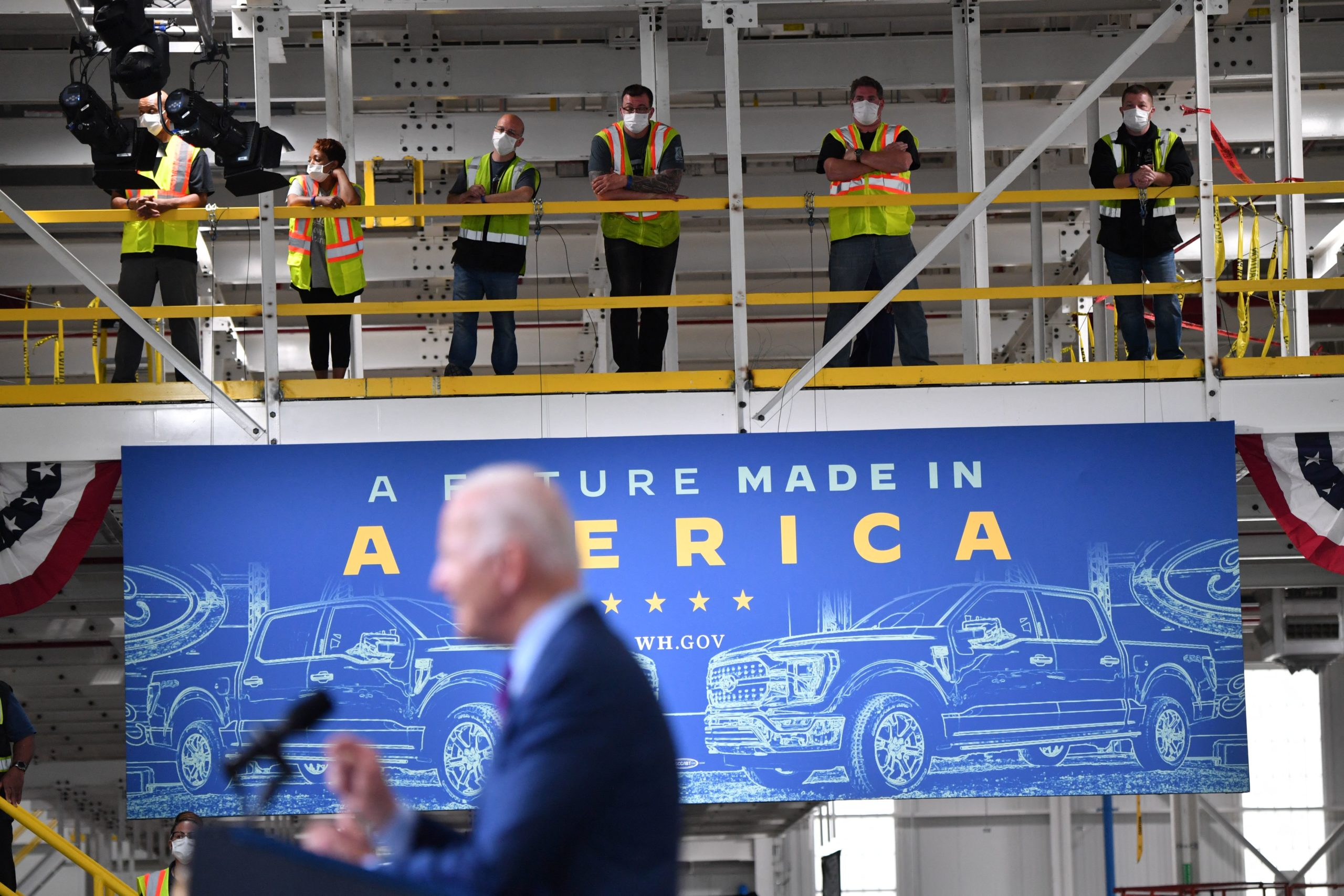 Workers listen to President Joe Biden speak about infrastructure at a Ford facility in Dearborn, Michigan on Tuesday. (Nicholas Kamm/AFP via Getty Images)