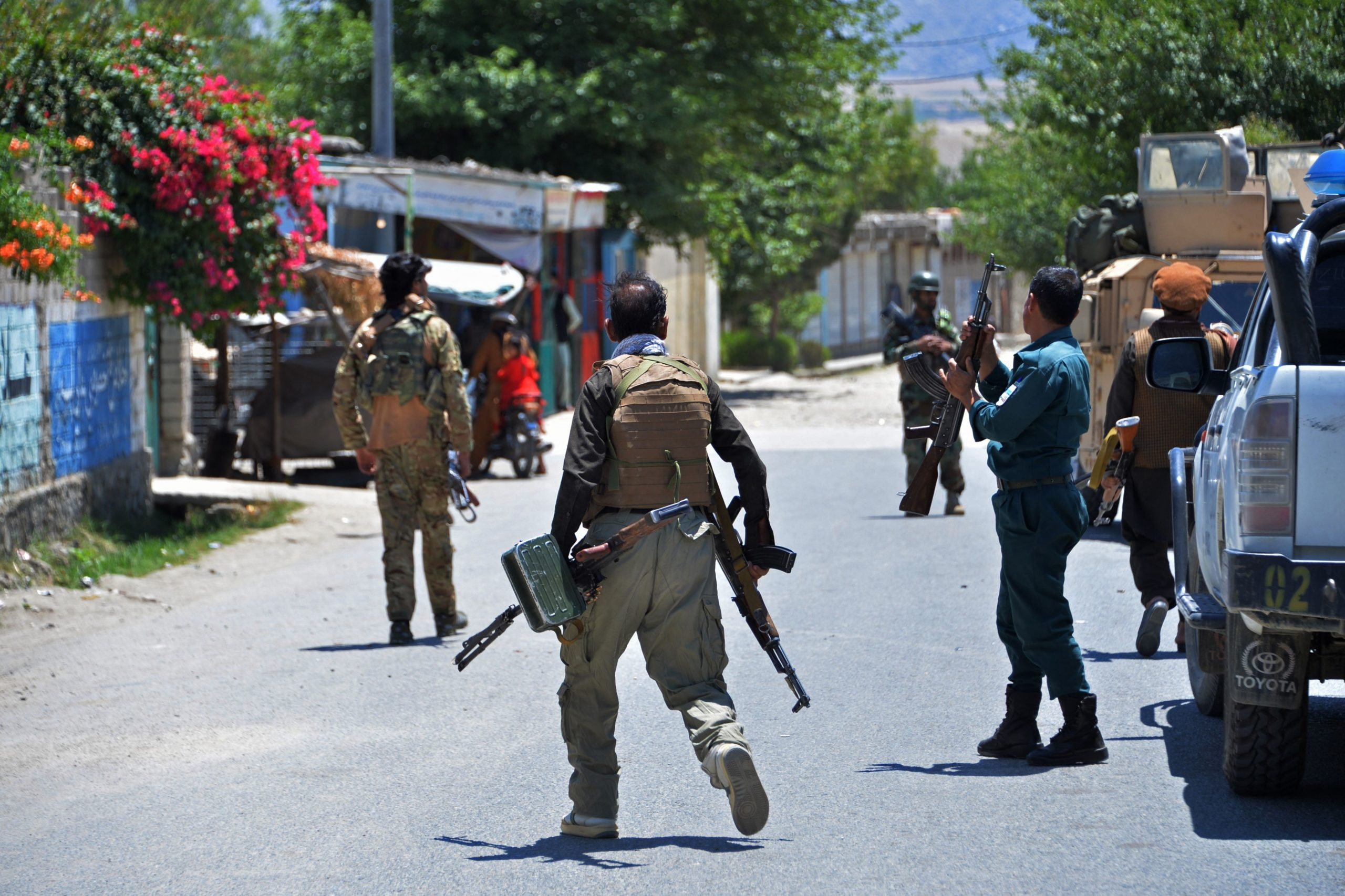 Members of Afghan security forces patrol a street during an ongoing clash between Taliban and Afghan forces in Mihtarlam. (Photo by NOORULLAH SHIRZADA/AFP via Getty Images)
