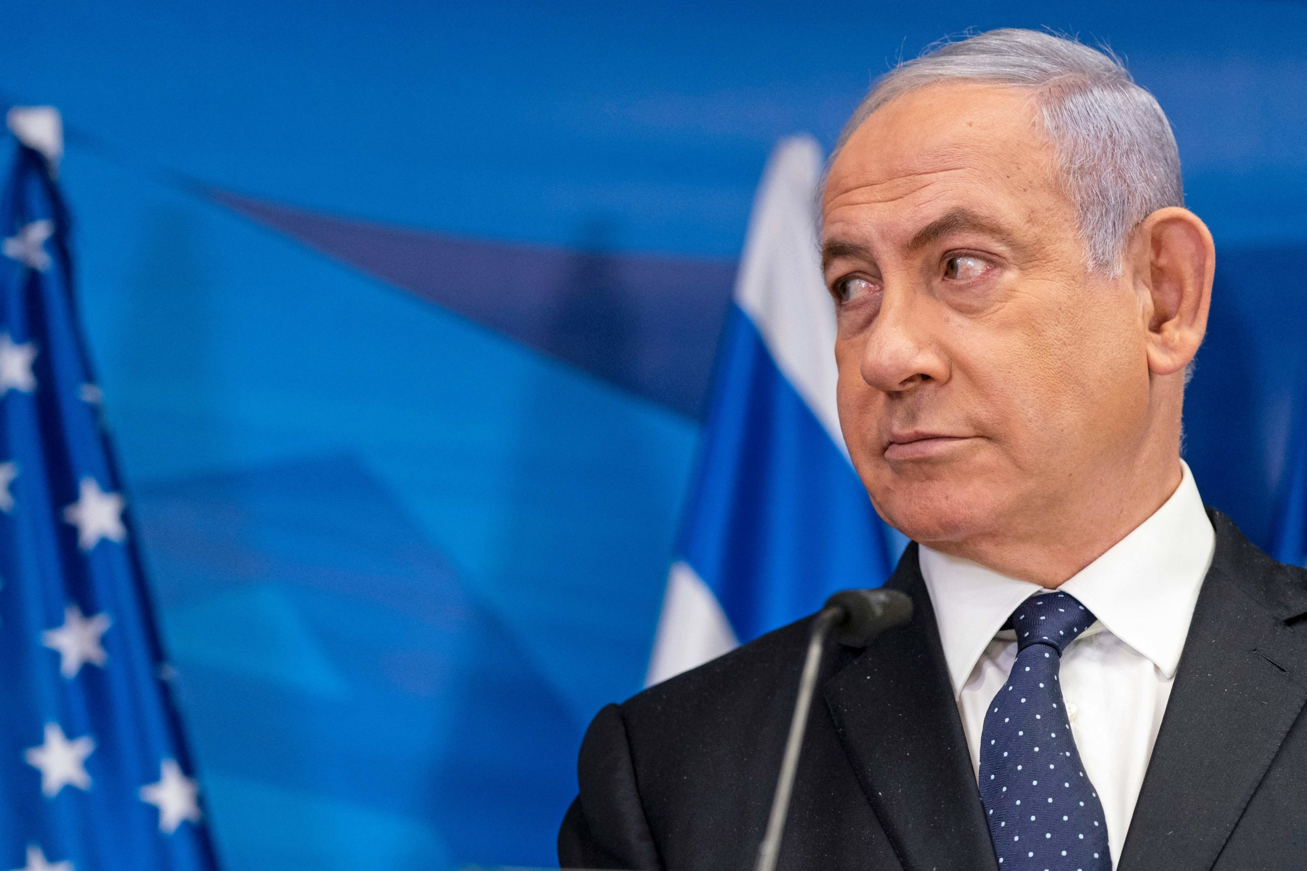Israeli Prime Minister Benjamin Netanyahu listens to US Secretary of State Antony Blinken (unseen) during a joint press conference in Jerusalem on May 25, 2021, days after an Egypt-brokered truce halted fighting between the Jewish state and the Gaza Strip's rulers Hamas. (ALEX BRANDON/POOL/AFP via Getty Images)
