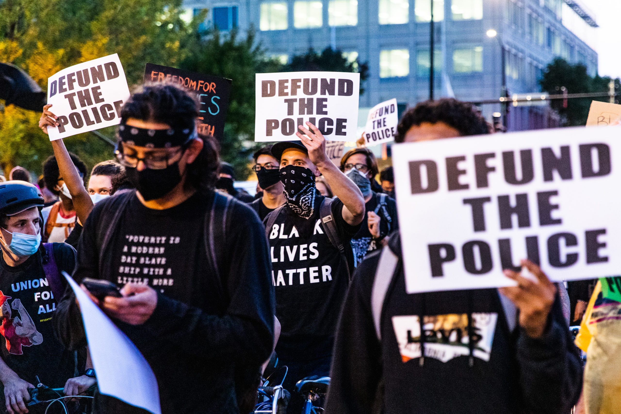Protesters carry signs in support of defunding the police during a march on Sept. 23 in Chicago, Illinois. (Natasha Moustache/Getty Images)