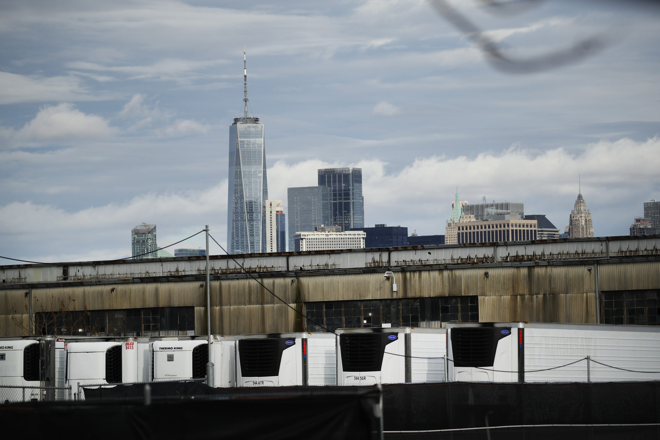 Refrigerated morgue trailers believed to be holding the bodies of people who died of COVID-19 are seen at South Brooklyn Marine Terminal on November 23, 2020 in New York City. (Photo by Spencer Platt/Getty Images)