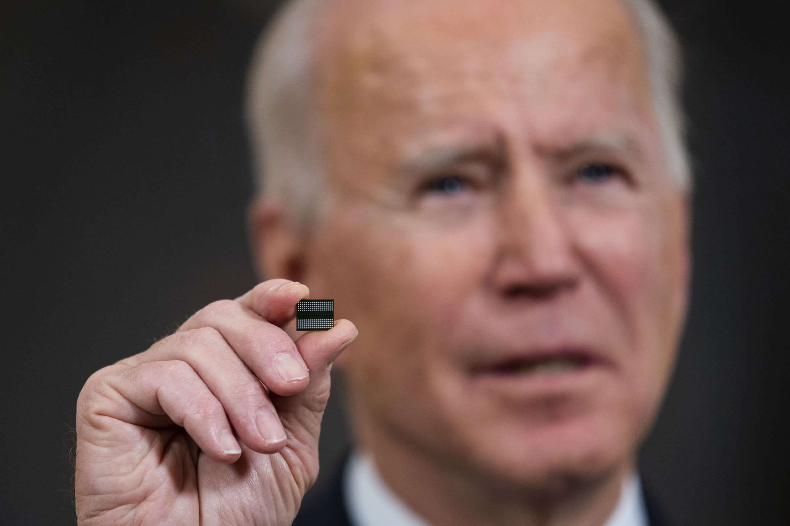 WASHINGTON, DC - FEBRUARY 24: U.S. President Joe Biden holds a semiconductor during his remarks before signing an Executive Order on the economy in the State Dining Room of the White House on February 24, 2021 in Washington, DC. (Photo by Doug Mills/Pool/Getty Images)