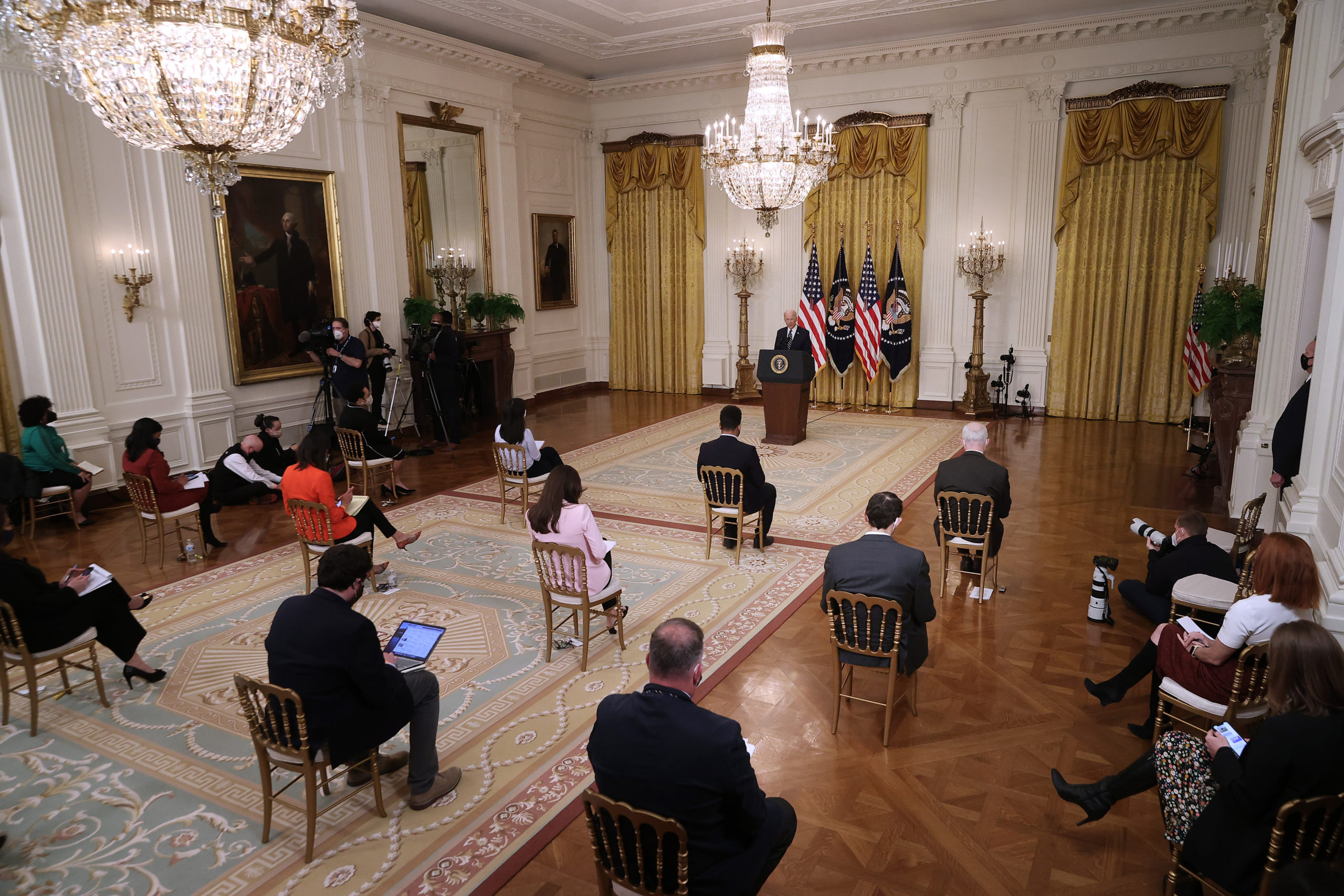 With reporters spaced out due to the ongoing coronavirus pandemic, U.S. President Joe Biden holds the first news conference of his presidency in the East Room of the White House on March 25, 2021 in Washington, DC. (Chip Somodevilla/Getty Images)