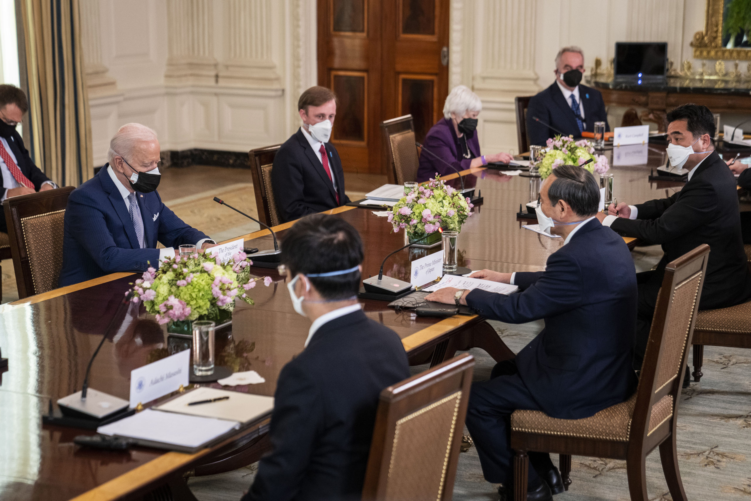 President Joe Biden, Treasury Secretary Janet Yellen and other U.S. officials meet with Japanese Prime Minister Yoshihide Suga at the White House on April 16. (Doug Mills/Pool/Getty Images)