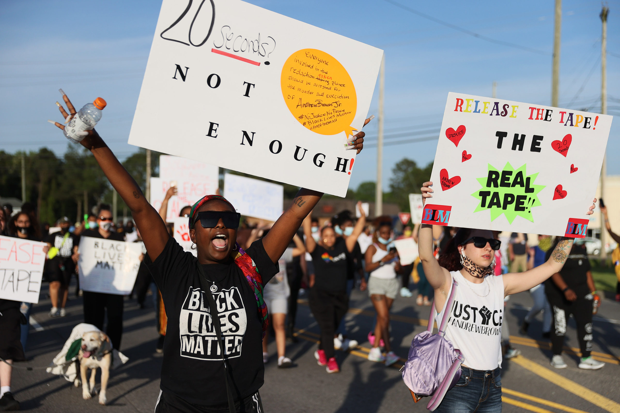 \Protesters march through the street calling for justice after the death of Andrew Brown Jr. on April 27, 2021 in Elizabeth City, North Carolina. (Photo by Joe Raedle/Getty Images)