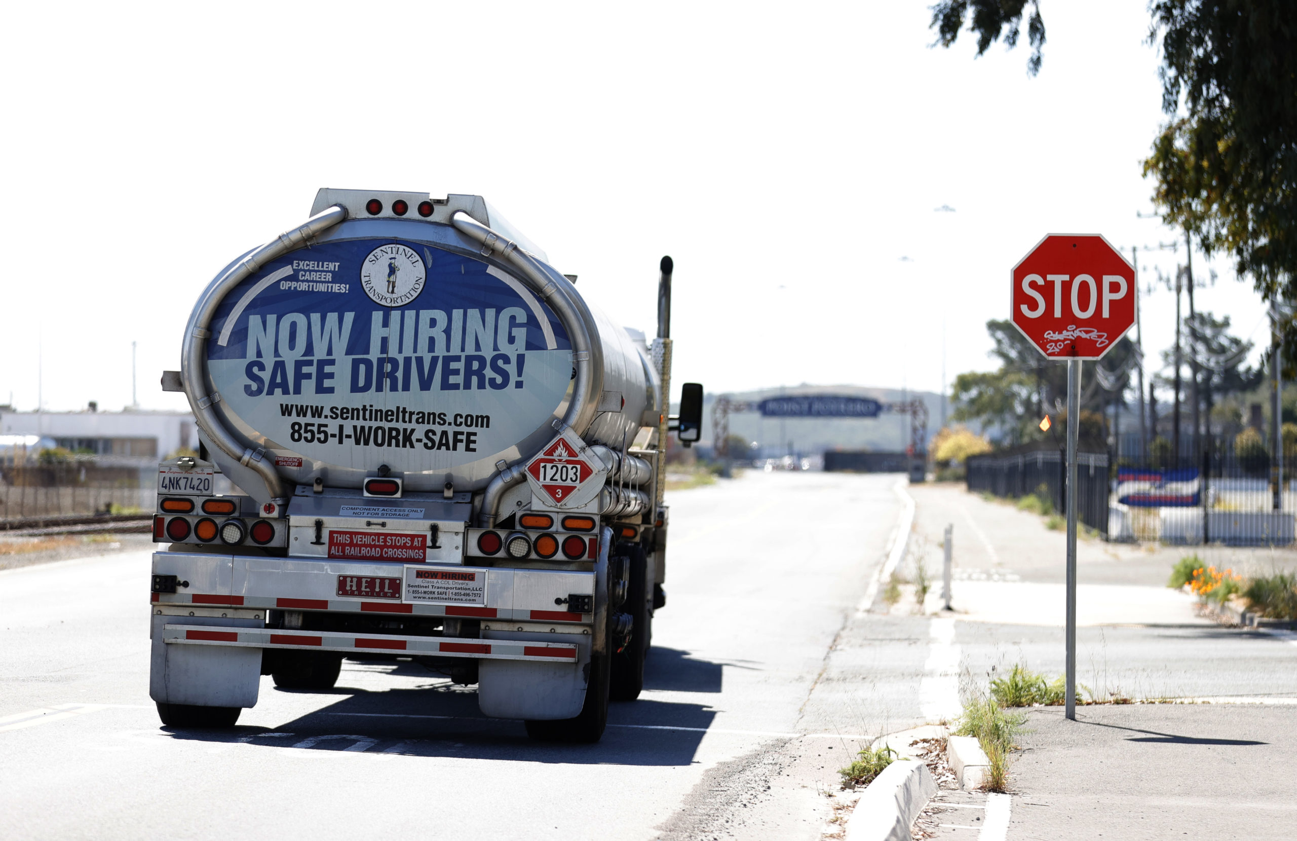 """A """"now hiring"""" advertisement is pictured on the back of a fuel truck on April 29 in Richmond, California.(Justin Sullivan/Getty Images)"""