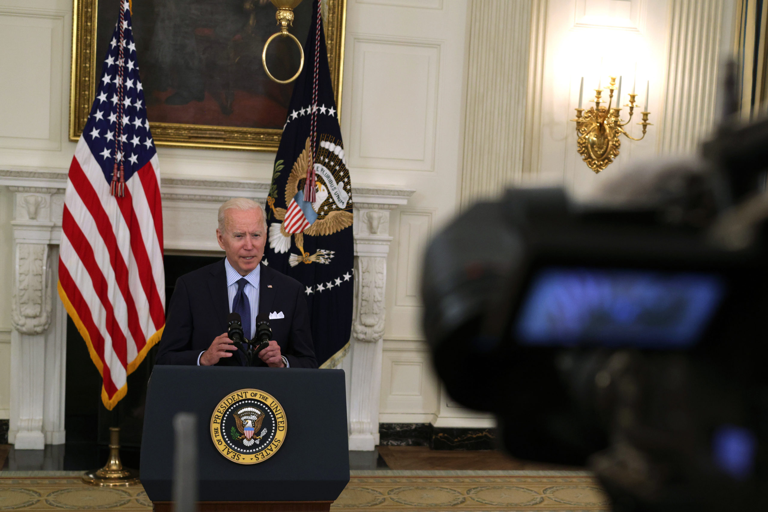 WASHINGTON, DC - MAY 04: U.S. President Joe Biden delivers remarks on the COVID-19 response and the vaccination program during an event at the State Dining Room of the White House May 4, 2021 in Washington, DC. President Biden set a new goal to have 70% of adult Americans with at least one shot and at least 160 Americans fully vaccinated by July 4th, 2021. (Photo by Alex Wong/Getty Images)