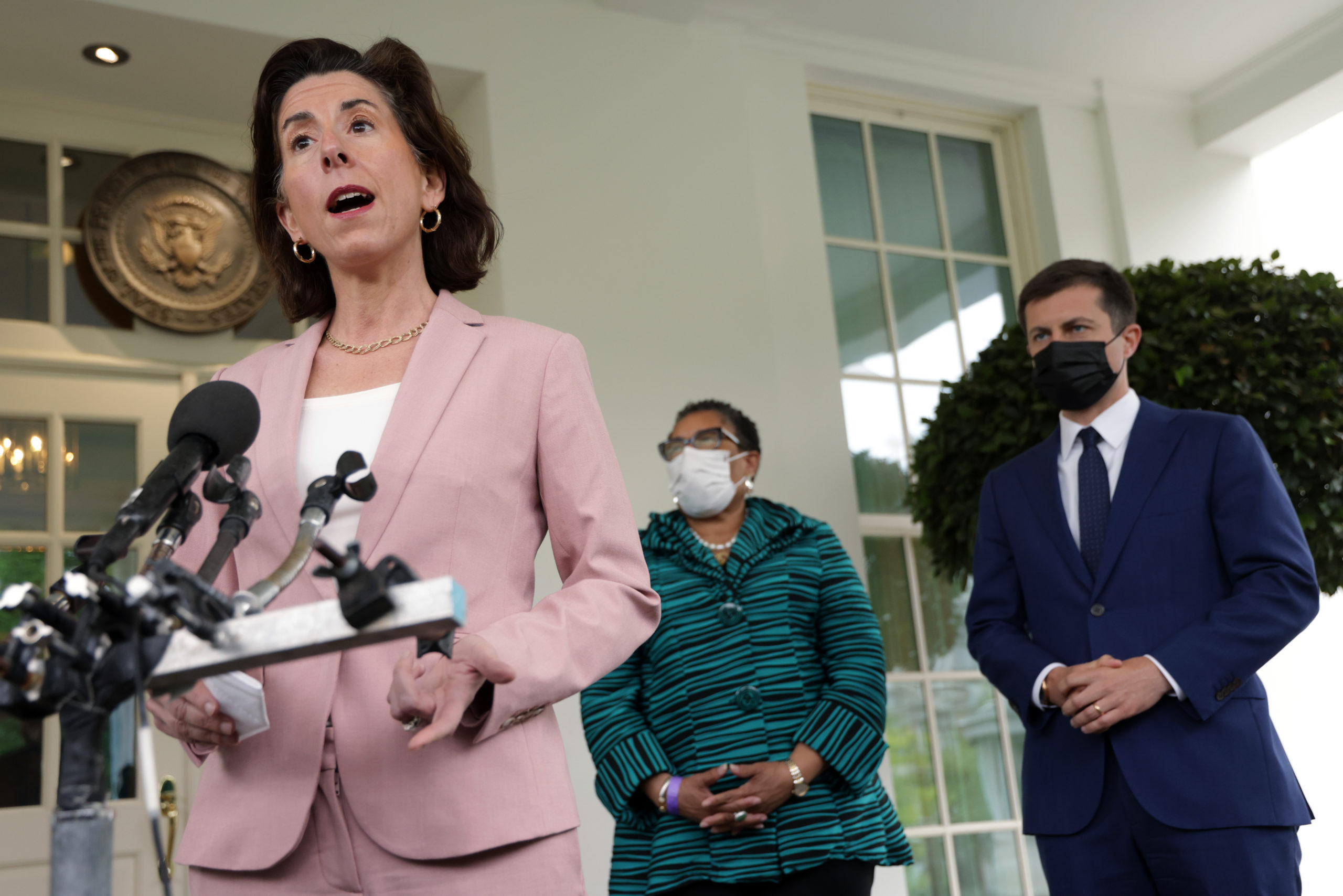 Commerce Secretary Gina Raimondo and other members of the White House jobs task force speak to reporters on May 7. (Alex Wong/Getty Images)