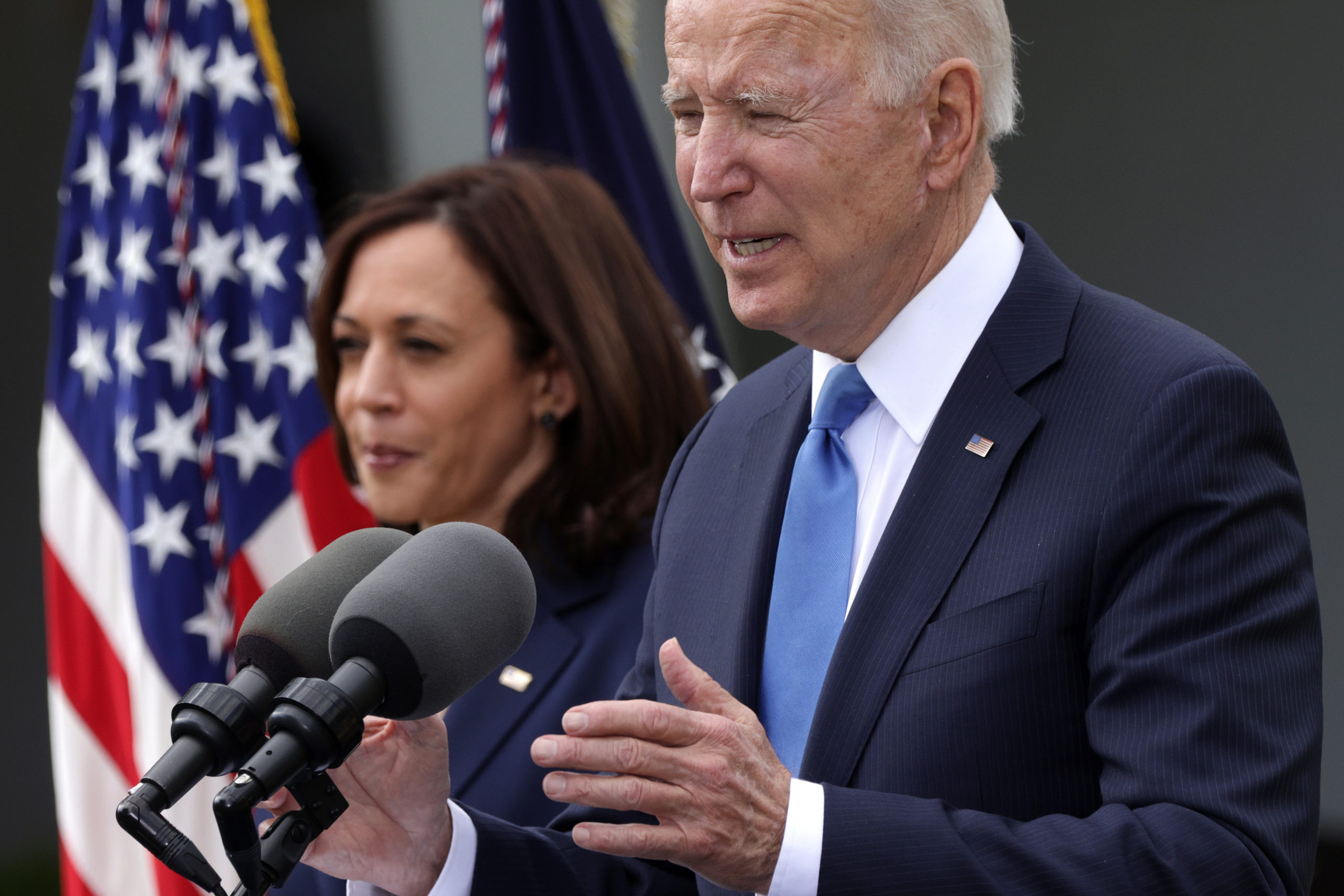 U.S. President Joe Biden delivers remarks on the COVID-19 response and vaccination program as Vice President Kamala Harris listens in the Rose Garden of the White House on May 13, 2021 in Washington, DC. (Alex Wong/Getty Images)
