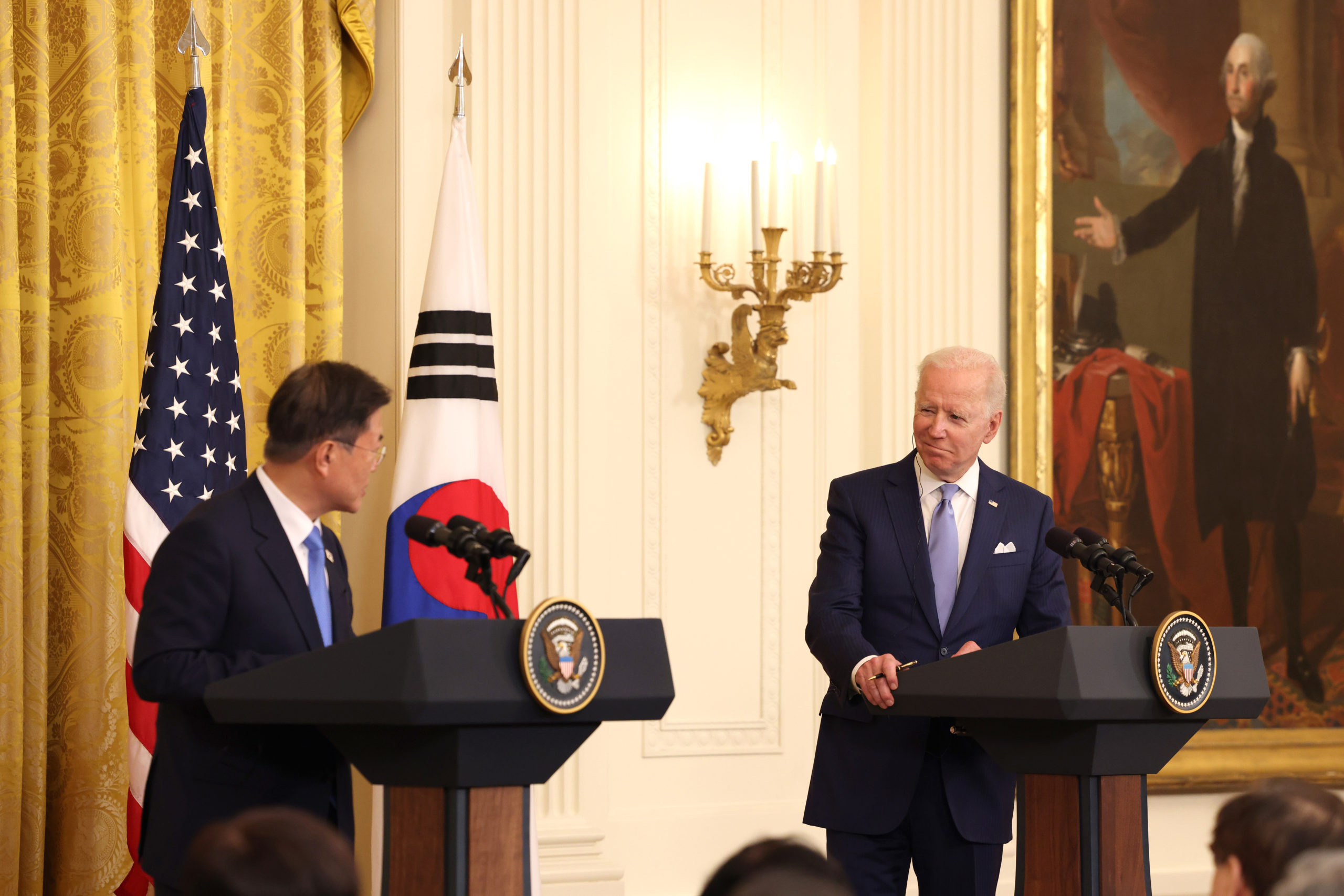WASHINGTON, DC - MAY 21: U.S. President Joe Biden (R) and South Korean President Moon Jae-in participate in a joint press conference in the East Room of the White House on May 21, 2021 in Washington, DC. Moon Jae-in is the second world leader to be hosted by President Biden at the White House. (Photo by Anna Moneymaker/Getty Images)