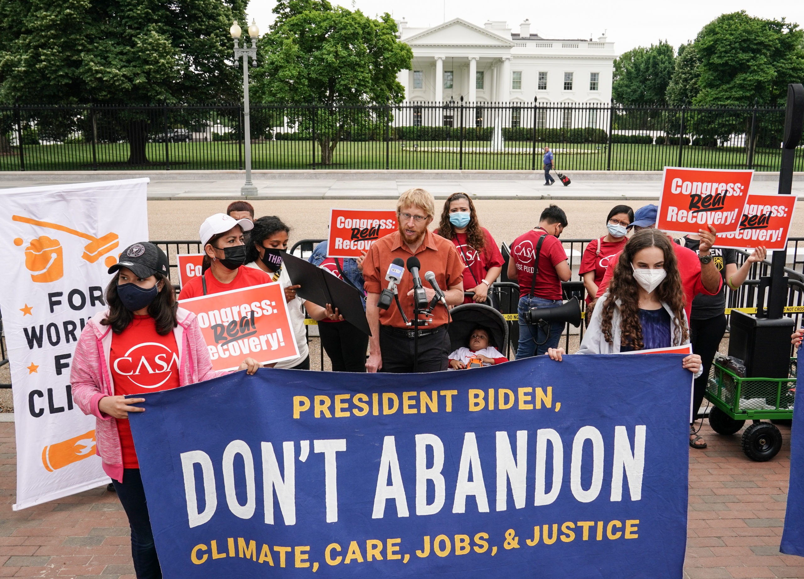 Activist Ben Beachy speaks during a May 24 demonstration calling on President Joe Biden not to compromise on his election promises. (Jemal Countess/Getty Images for Green New Deal Network)