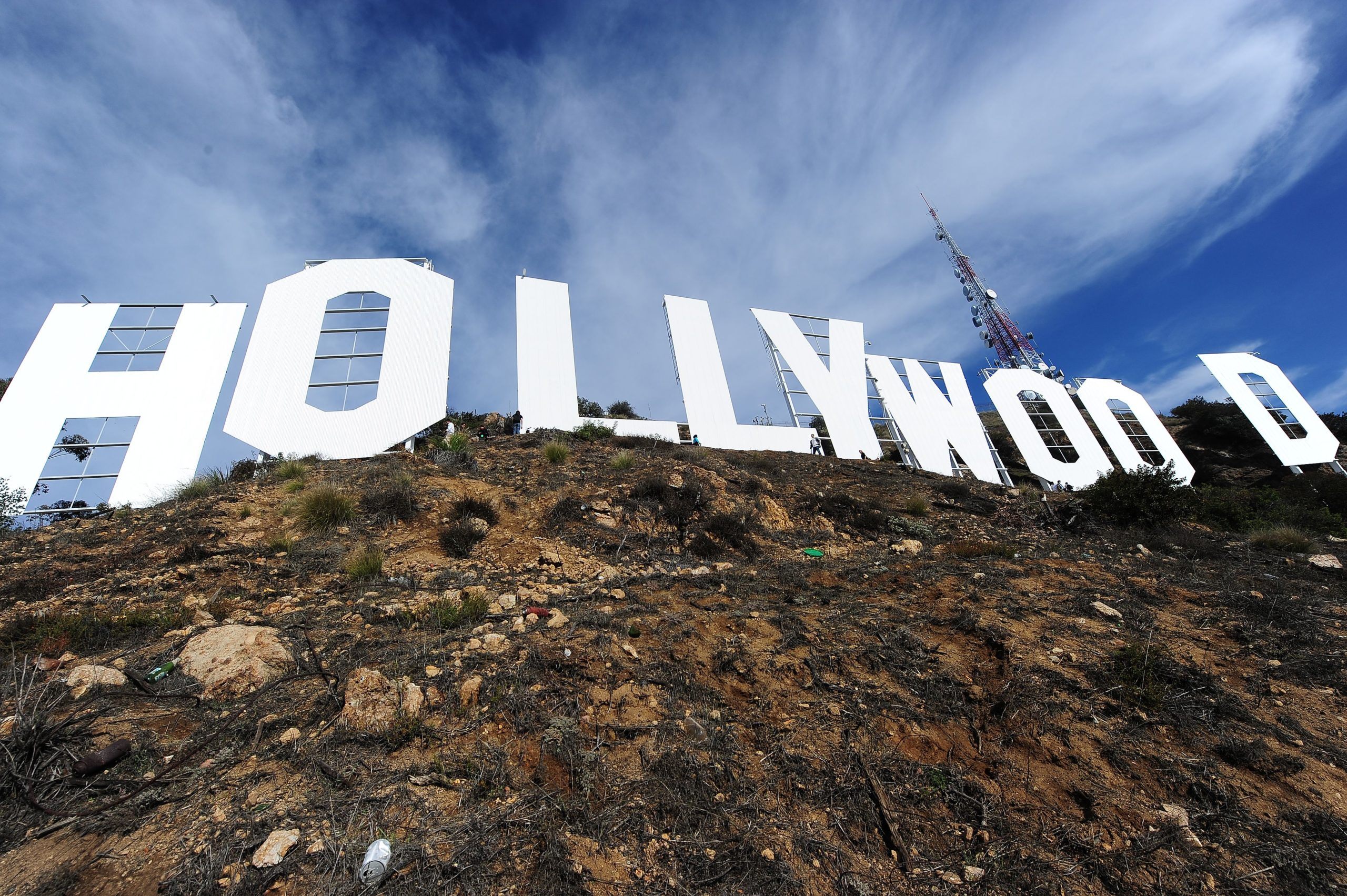 The freshly painted Hollywood Sign is seen after a press conference to announce the completion of the famous landmark's major makeover, December 4, 2012 in Hollywood, California. Some 360 gallons (around 1,360 liters) of paint and primer were used to provide the iconic sign with it most extensive refurbishment in almost 35 years in advance of it's 90th birthday next year. AFP PHOTO / Robyn Beck (Photo by Robyn BECK / AFP) (Photo by ROBYN BECK/AFP via Getty Images)