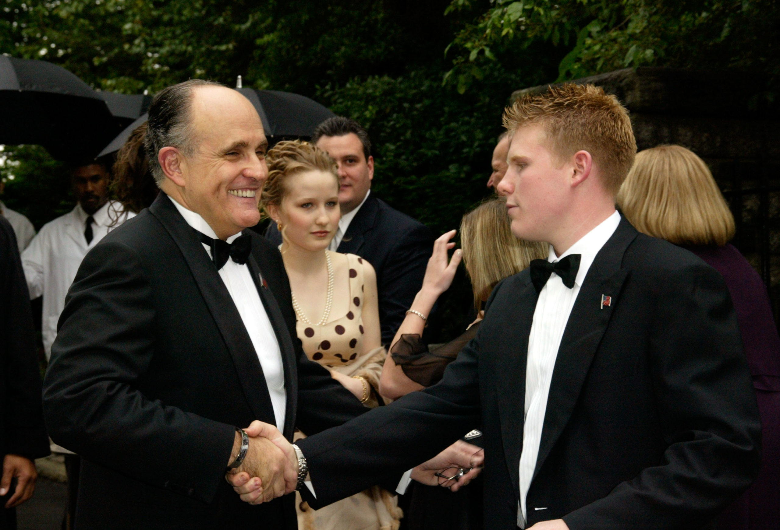 Rudolph Giuliani shakes hands with his best man/son Andrew Giuliani at the wedding of Rudolph Giuliani and Judith Nathan at Gracie Mansion May 24th , 2003 in New York City. (Matthew Peyton/Getty Images)