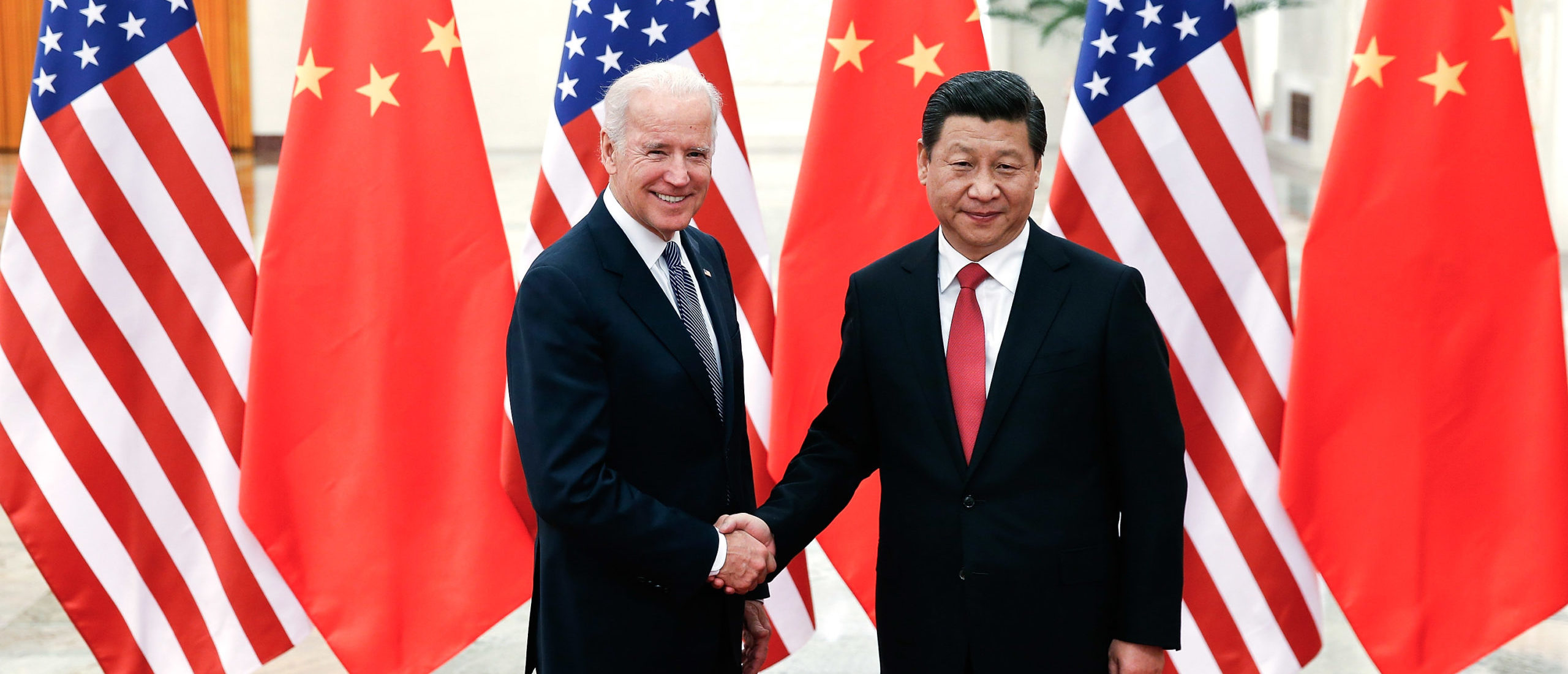 Chinese President Xi Jinping shake hands with President Joe Biden on Dec. 4, 2013 in Beijing, China. (Lintao Zhang/Getty Images)