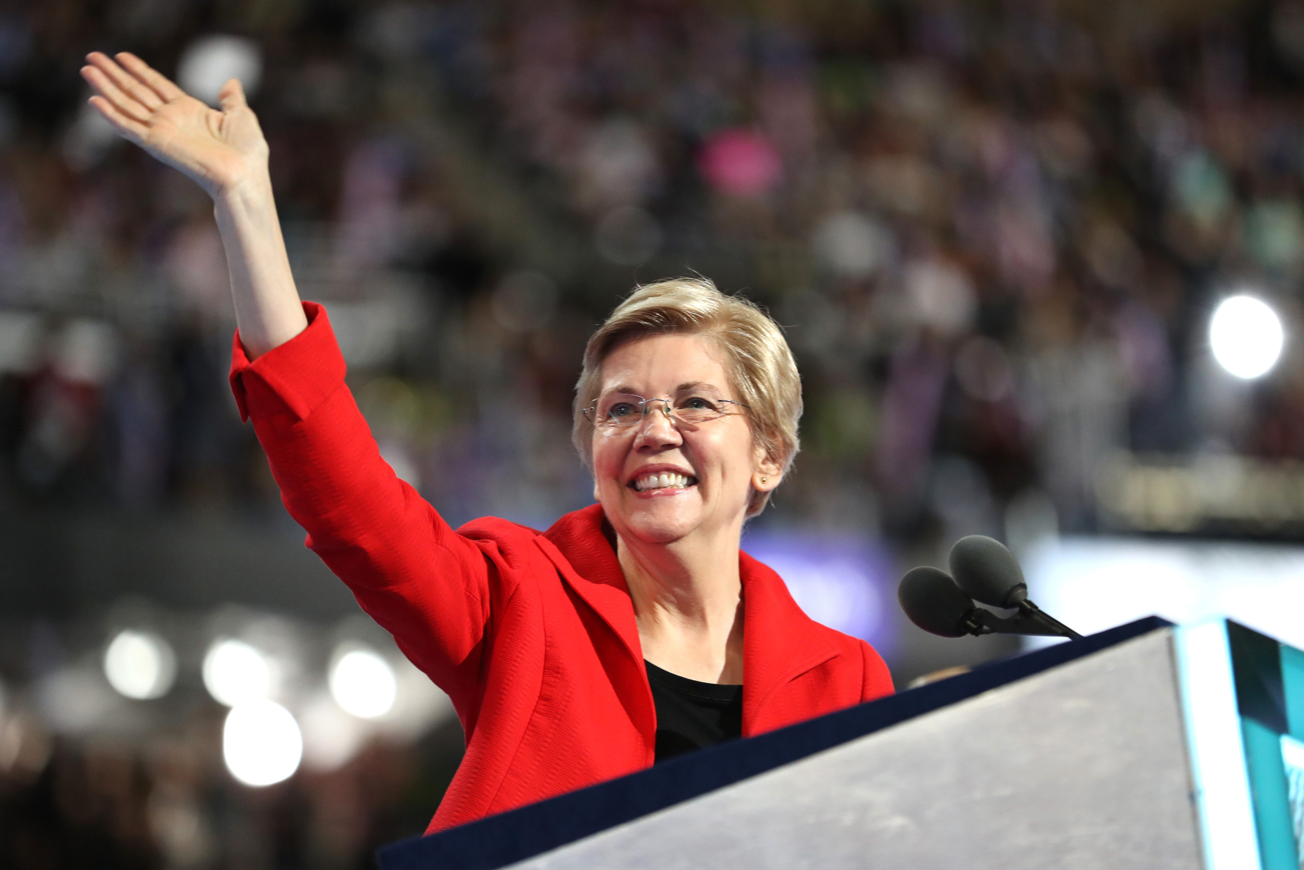 Sen. Elizabeth Warren (D-MA) acknowledges the crowd as she walks on stage to deliver remarks on the first day of the Democratic National Convention at the Wells Fargo Center, July 25, 2016 in Philadelphia, Pennsylvania. An estimated 50,000 people are expected in Philadelphia, including hundreds of protesters and members of the media. The four-day Democratic National Convention kicked off July 25. (Photo by Joe Raedle/Getty Images)