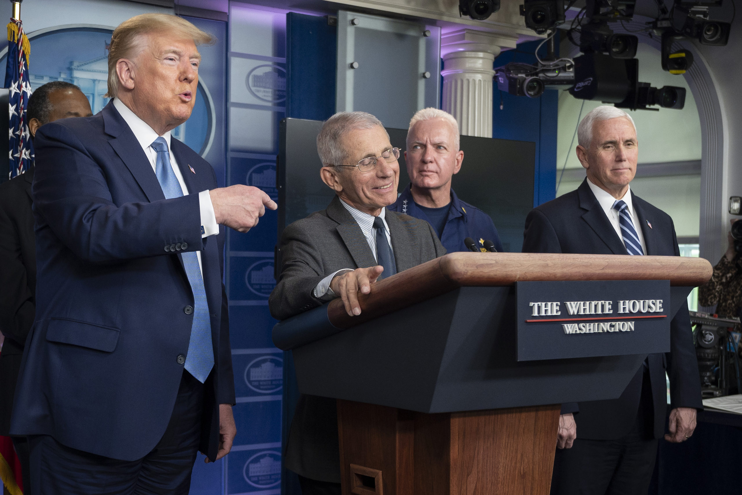 US President Donald Trump (L) gestures as National Institute of Allergy and Infectious Diseases Director, Dr. Anthony Fauci, smiles during the daily briefing on the novel coronavirus, COVID-19, at the White House on March 21, 2020, in Washington, DC. (JIM WATSON/AFP via Getty Images)