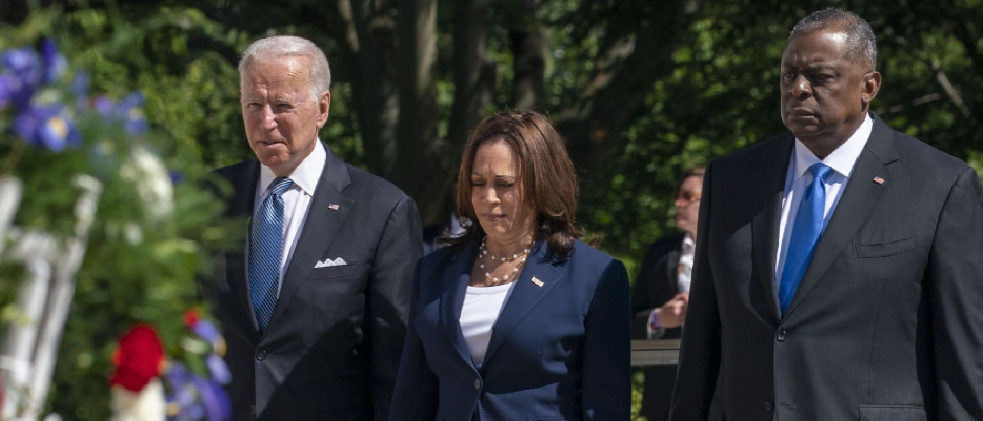 U.S. President Joe Biden, from left, U.S. Vice President Kamala Harris, and Lloyd Austin, U.S. secretary of defense, arrive for a wreath laying ceremony at the Tomb of the Unknown Soldier at Arlington National Cemetery in Arlington, Virginia, U.S., on Monday, May 31, 2021. Biden's $6 trillion budget request proposes record spending to reduce historical disparities in underserved communities, following his campaign pledge to promote racial equity as an inseparable part of rebuilding the economy. Photographer: Tasos Katopodis/UPI/Bloomberg via Getty Images