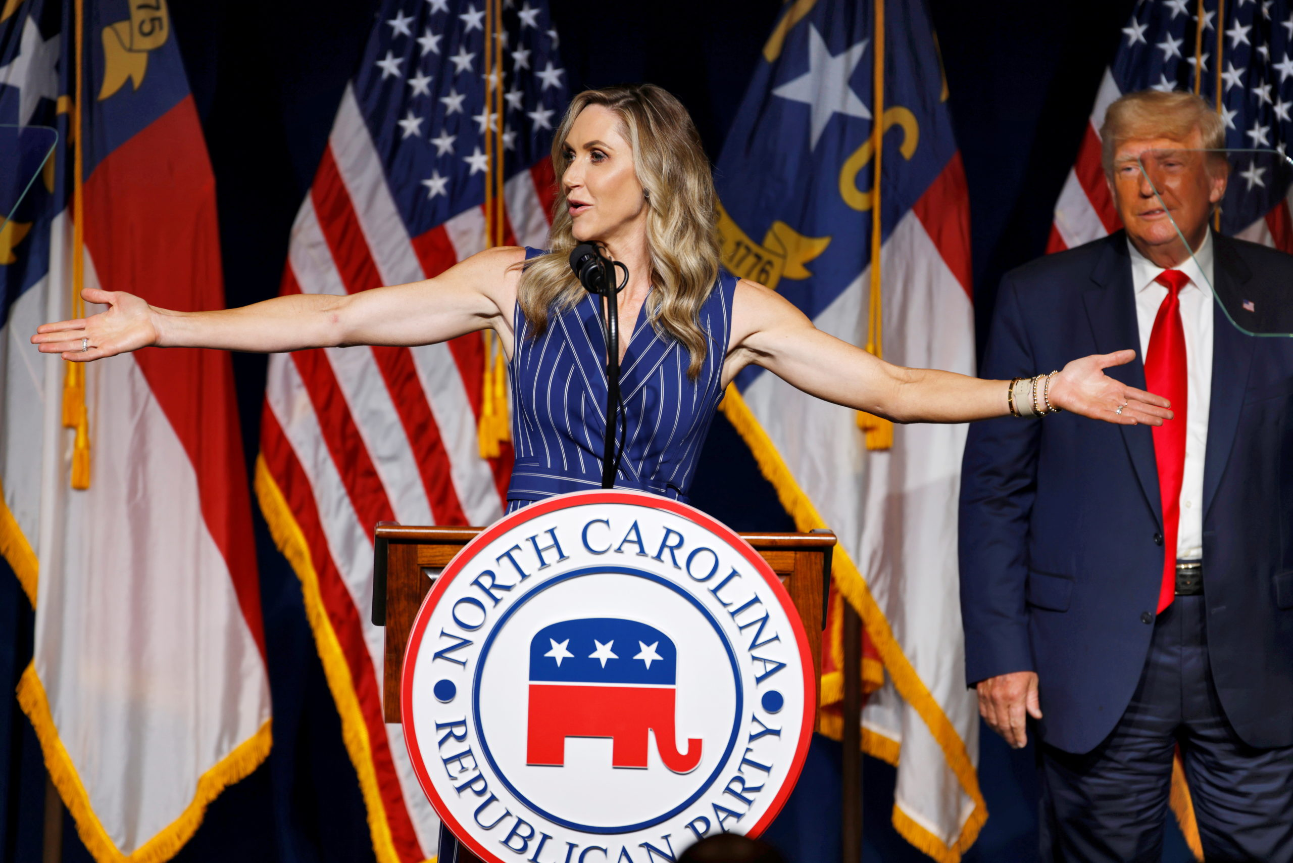 Lara Trump addresses the audience as her father-in-law, former U.S. President Donald Trump, looks on at the North Carolina GOP convention dinner in Greenville, North Carolina, U.S. June 5, 2021. [REUTERS/Jonathan Drake]